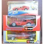 A Corgi Ferrari 308, two Burago Ferraris, 250GT0 and F1,