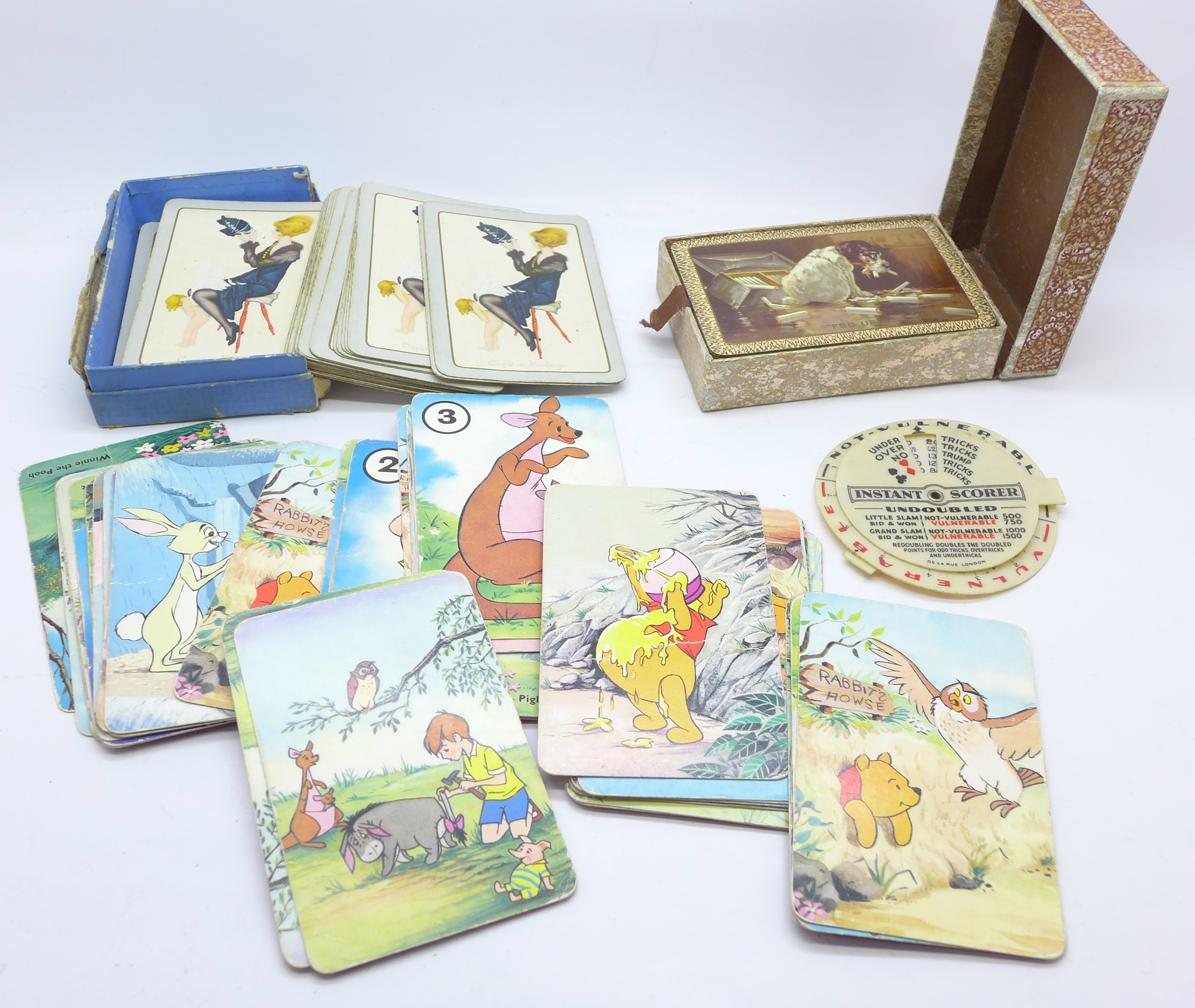 Lot 648 - Three packets of playing cards and a bridge scorer