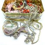 A tin of costume jewellery, 1.