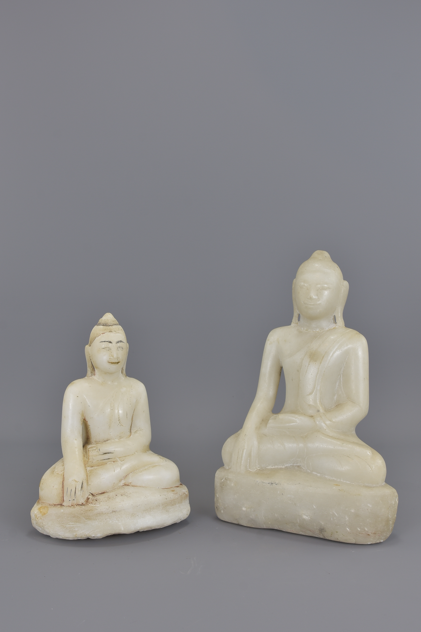 Lot 207 - Two Cambodian 19th century marble seated buddhas.