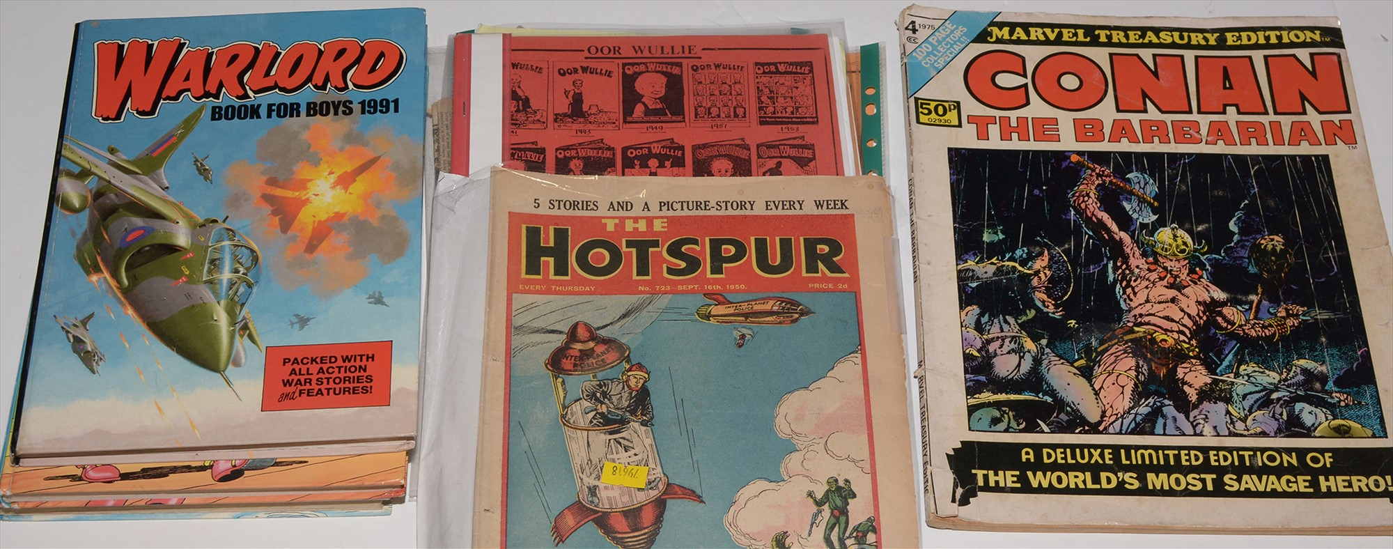 The Hotspur and other comics and annuals.