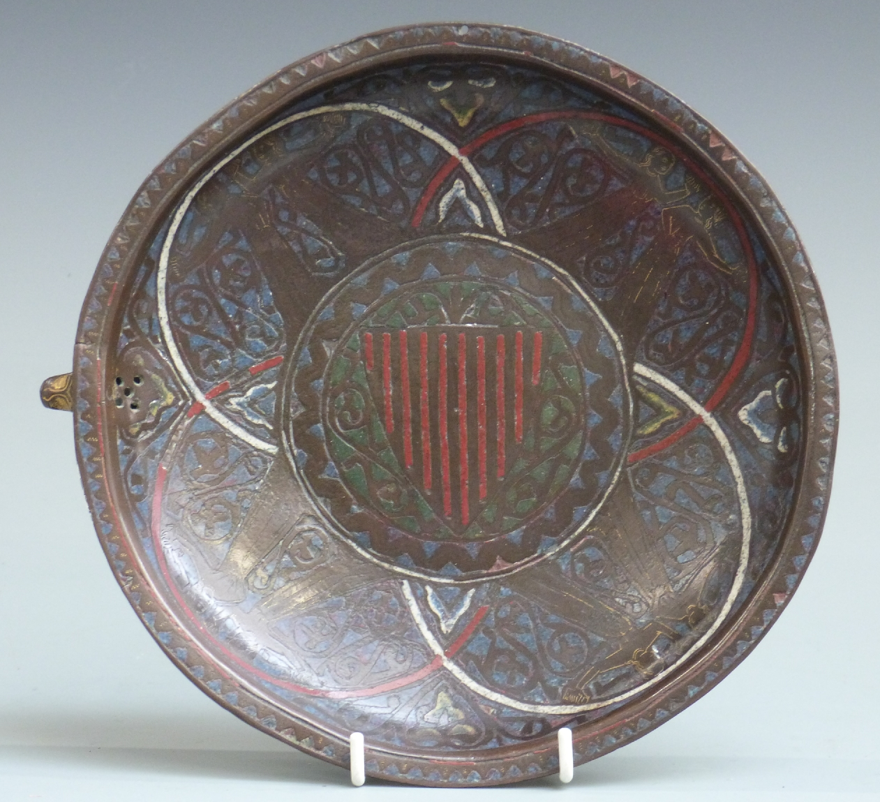 A 13thC French copper and polychrome champlevé enamel gemellion of typical shallow dished form,