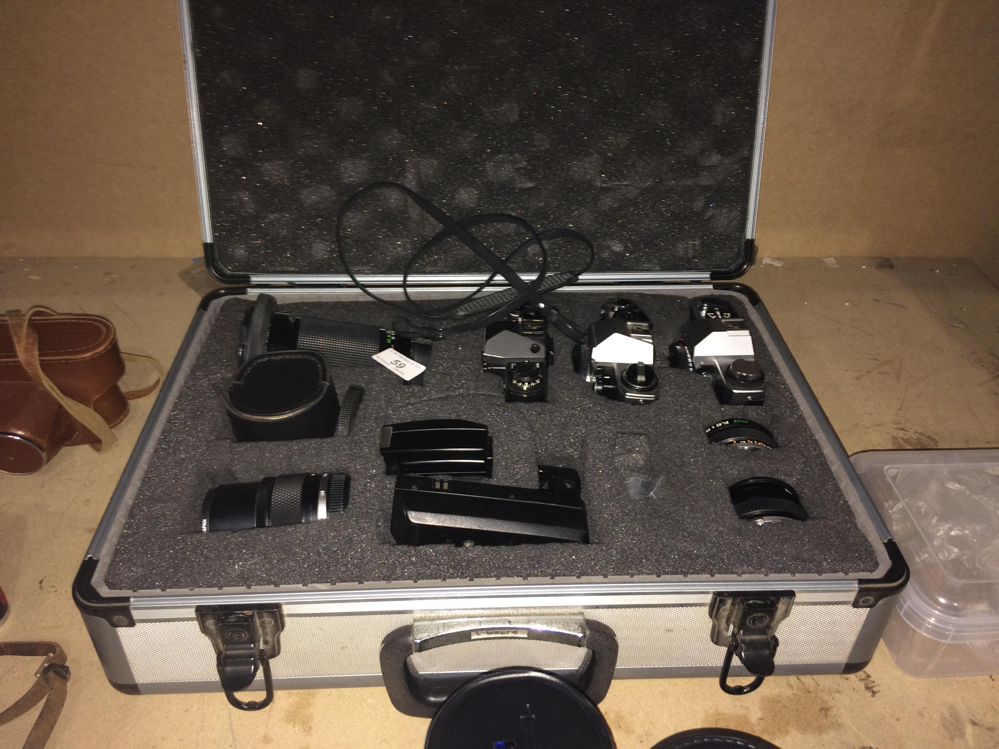 Lot 59 - Aluminium camera case and contents - Olympus OM20 camera, Olympus OM10 camera, Olympus OM-4 camera,