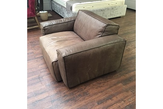 Lot 47 - Buddy Medium Sofa – 1 Seater Sioux Tobacco Leather The Buddy Sofa Projects A Strong Presence