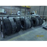 LOT CONSISTING OF: used truck tires (11), spare brake pads & tire rack