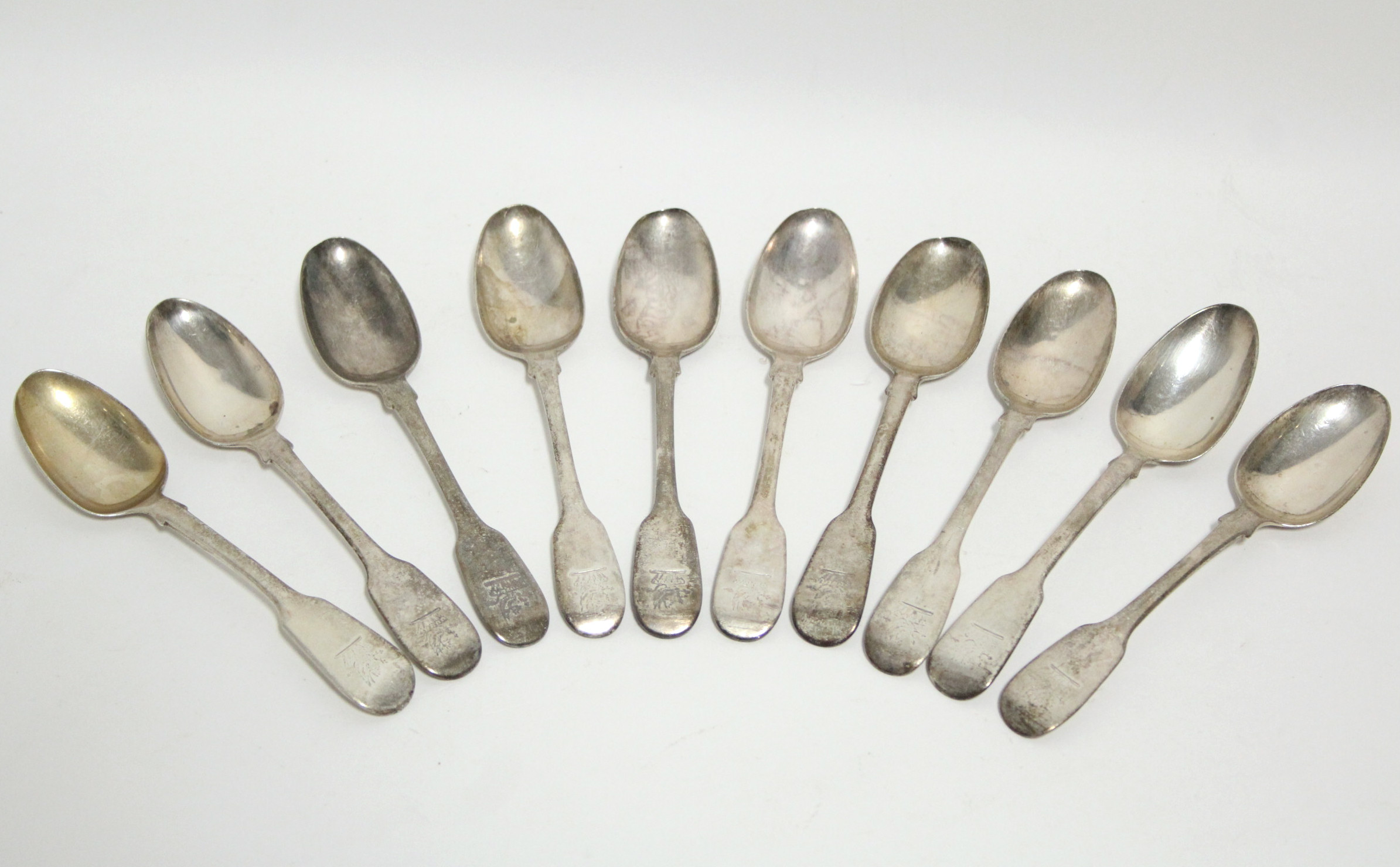 Lot 38 - Ten George IV Fiddle pattern teaspoons; London 1829, by William Eaton. (7½ oz).