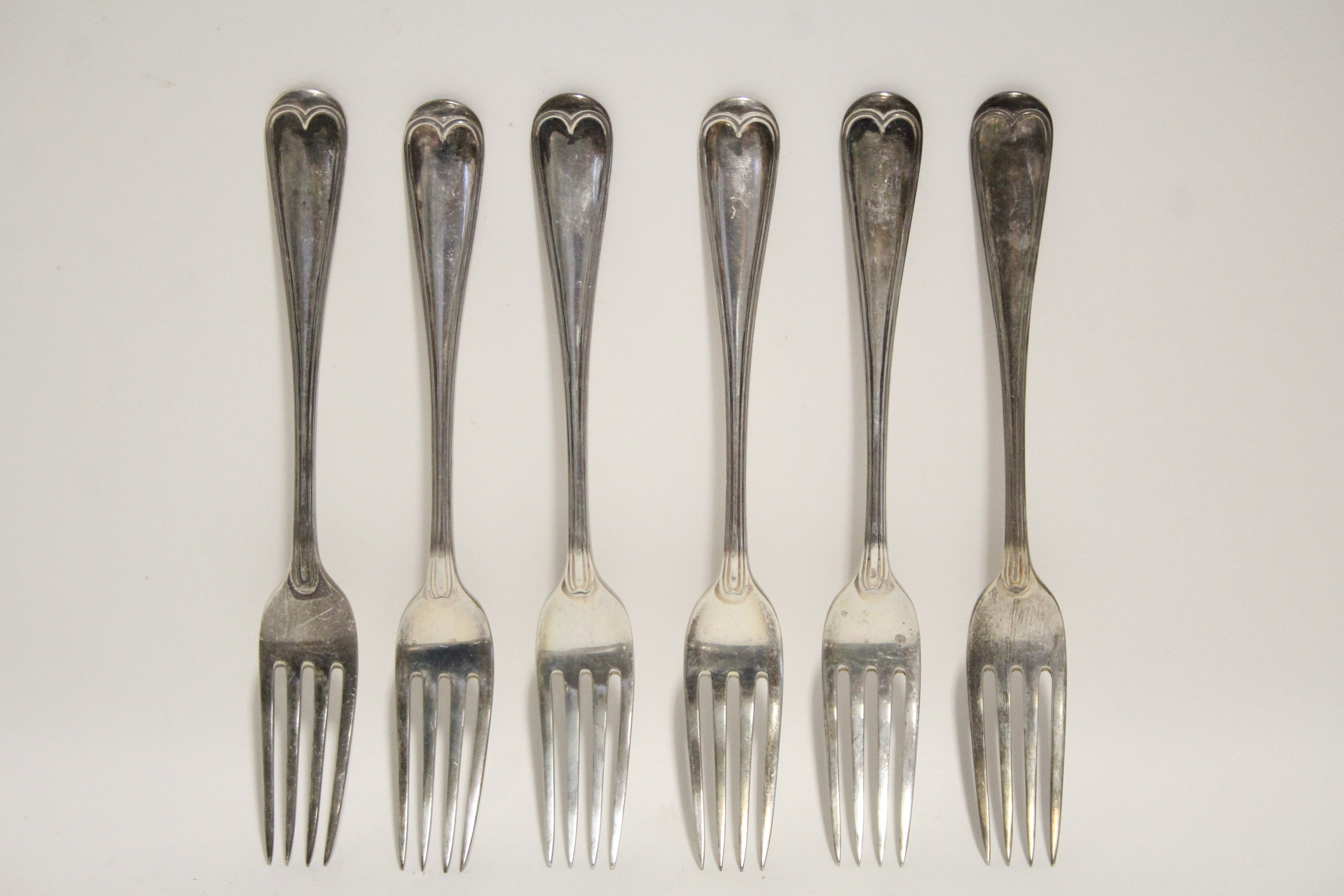 Lot 25 - Six late Victorian Old English & Thread pattern dessert forks; London 1899, by W. S. Hutton &