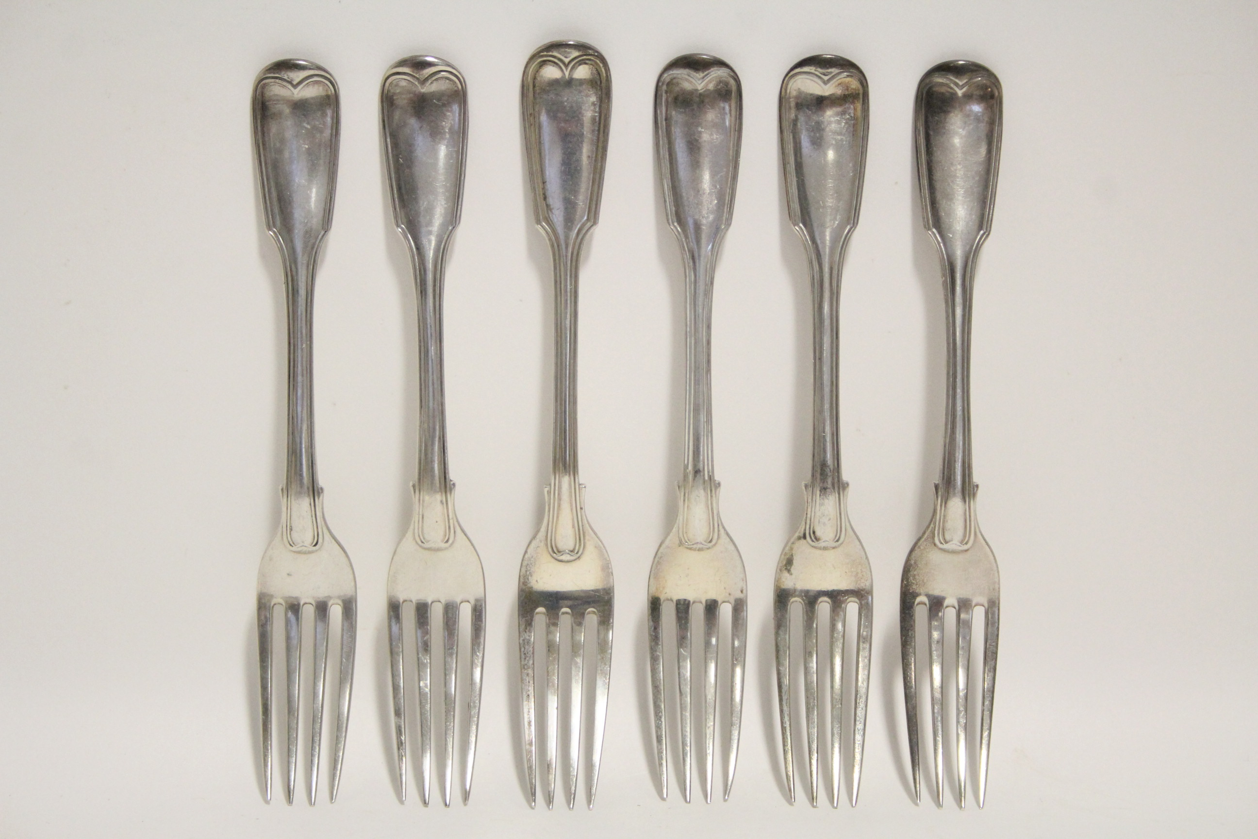 Lot 22 - Six Victorian Fiddle & Thread pattern table forks; London 1843, by John Hames Whiting; one 1887 –