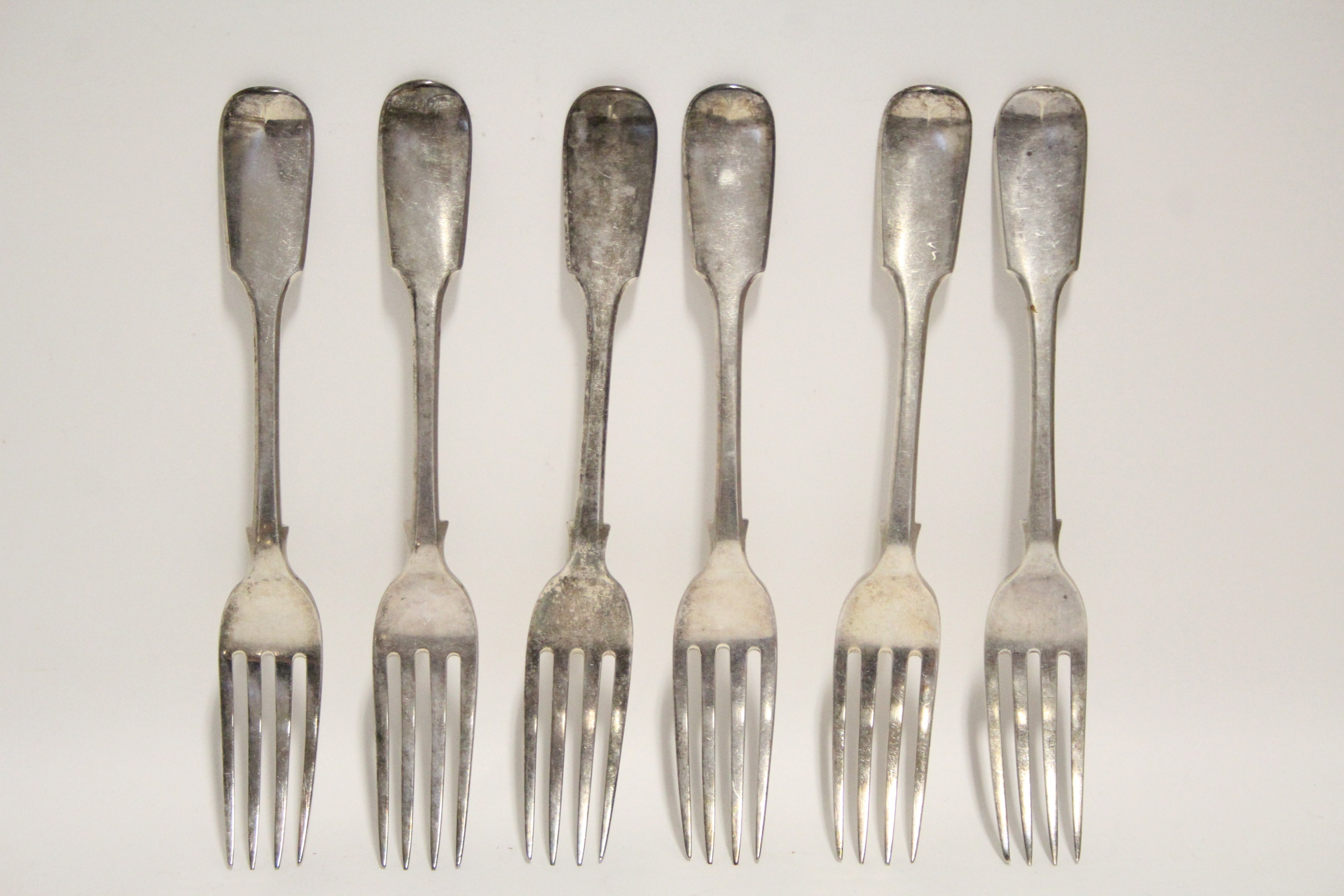 Lot 31 - Six William IV Fiddle pattern table forks; London 1836, by William Eaton. (14 oz).