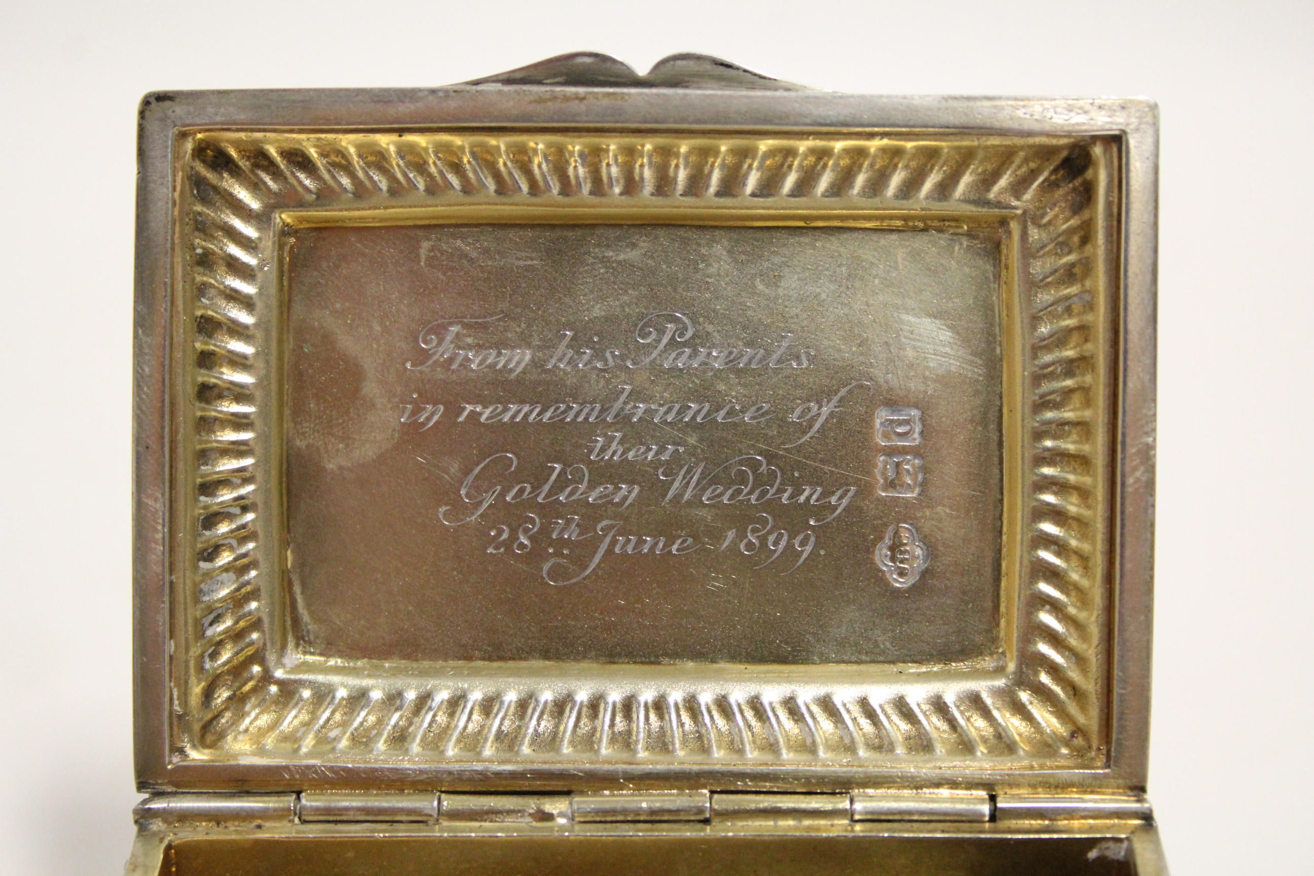 Lot 9 - A late Victorian rectangular box with gadrooned border & engraved inscription to the hinged lid,