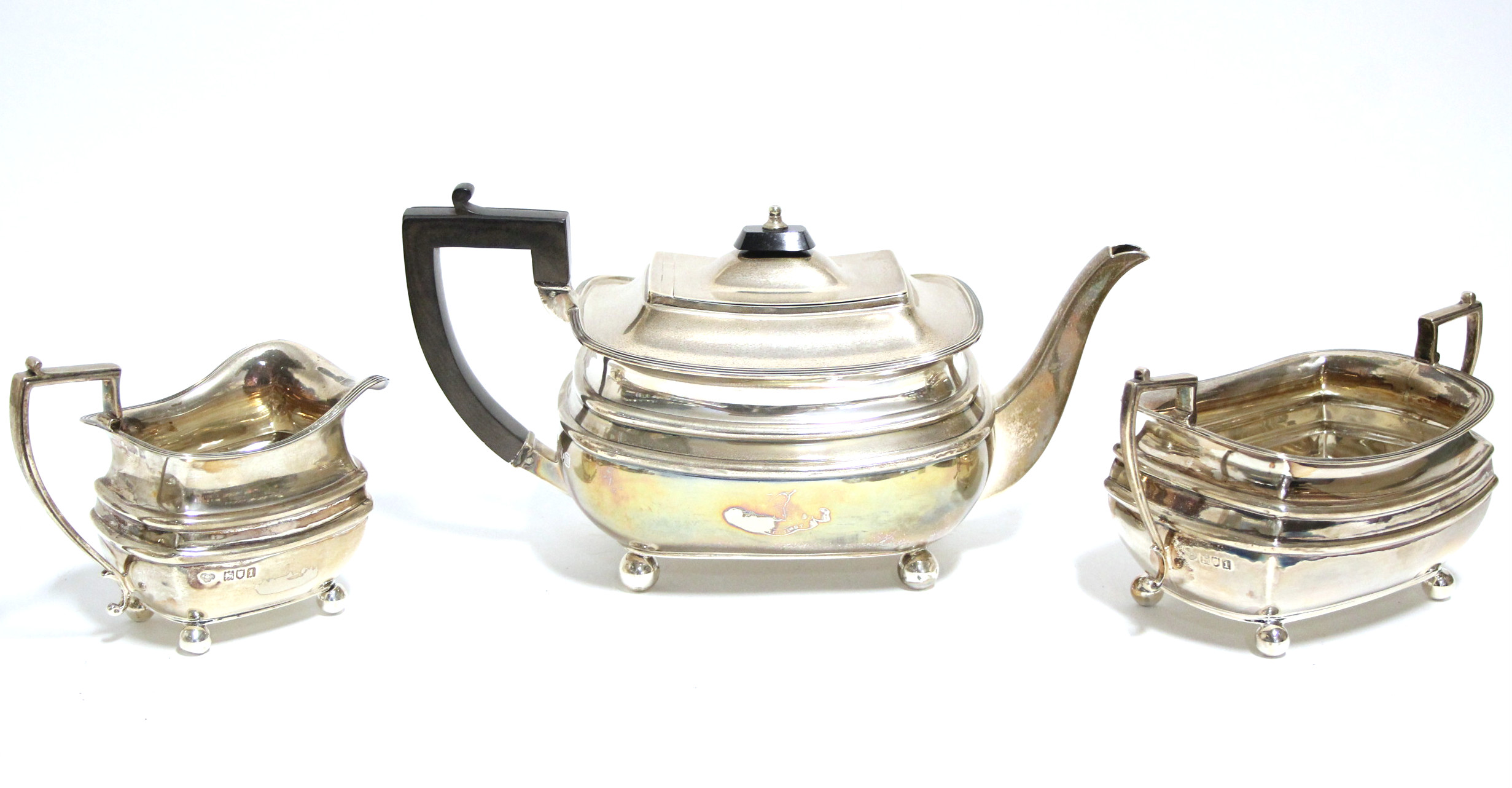 Lot 6 - An Edwardian three-piece tea service in the regency style, of compressed oblong form, each with