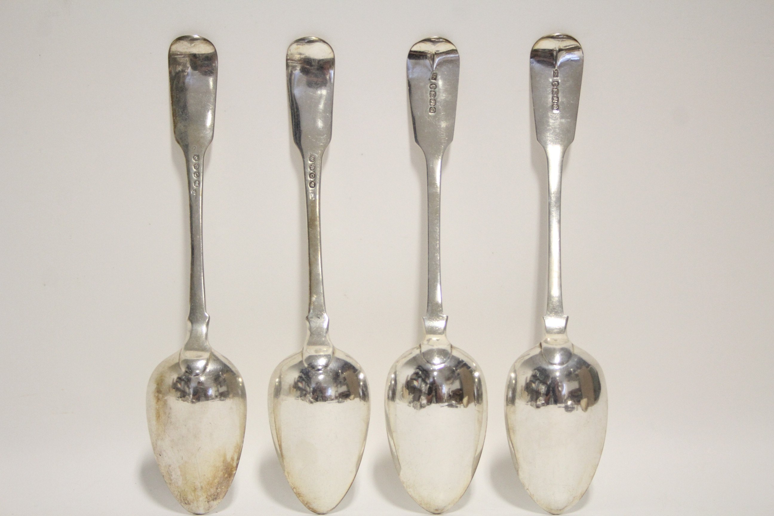 Lot 23 - A pair of George III Fiddle pattern table spoons, London 1809 by Solomon Hougham (probably); & a