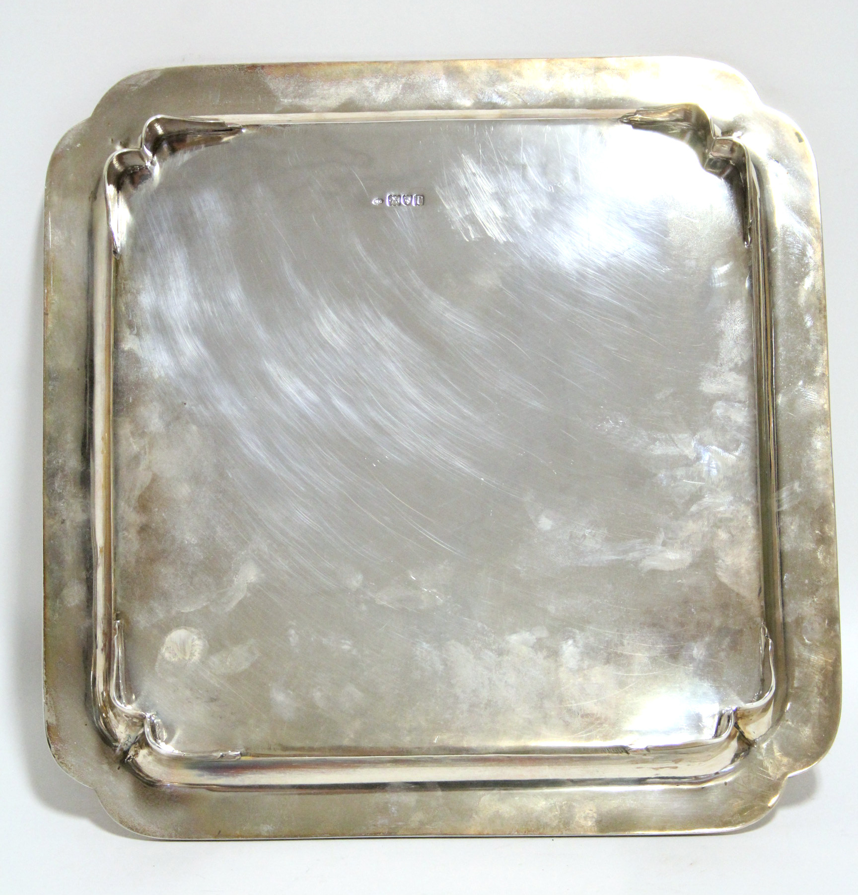 Lot 43 - A George V heavy-gauge square tray with re-entrant corners & moulded rim to the raised border, on