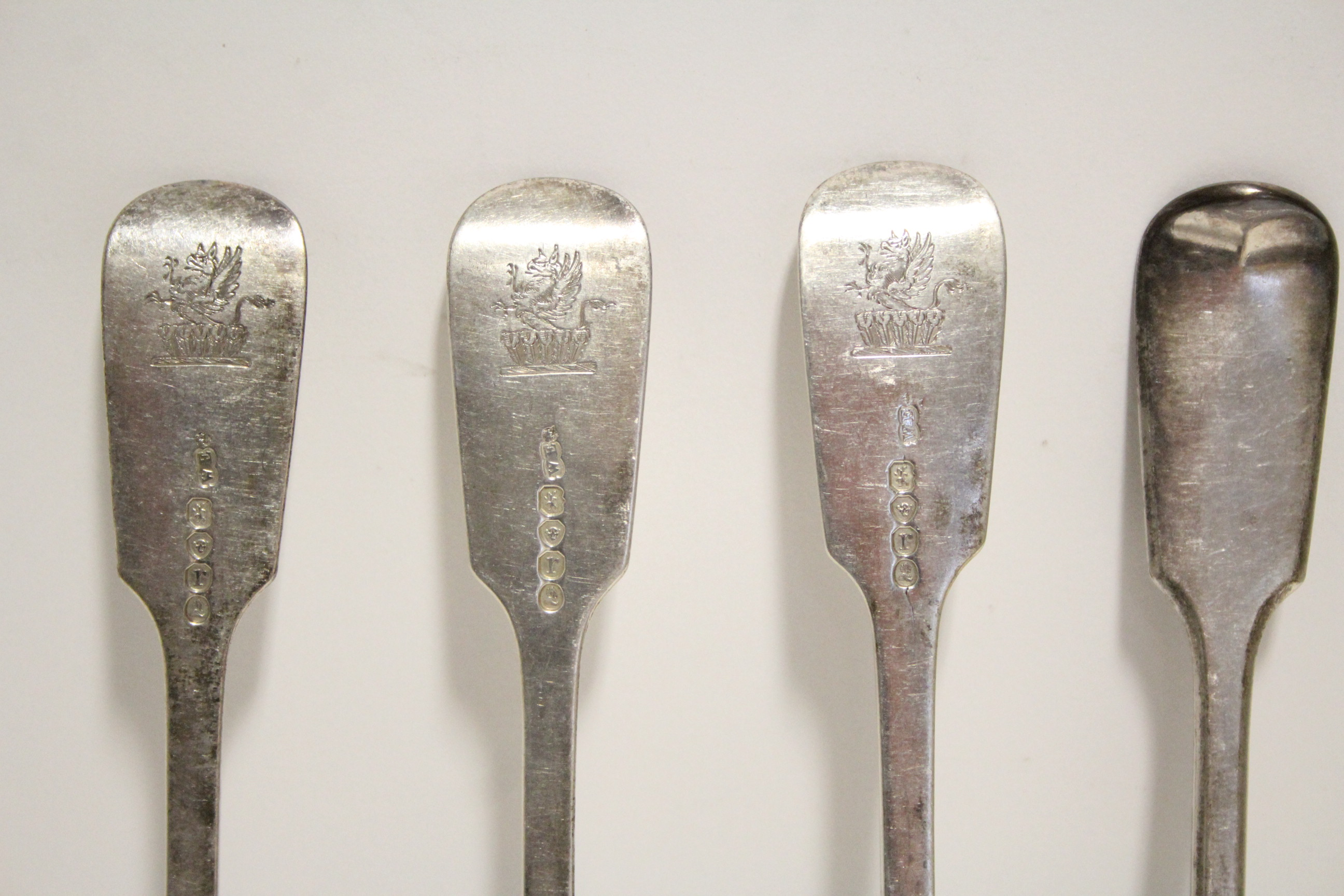 Lot 32 - Nine William IV Fiddle pattern table forks; London 1832, by William Eaton. (20 oz).