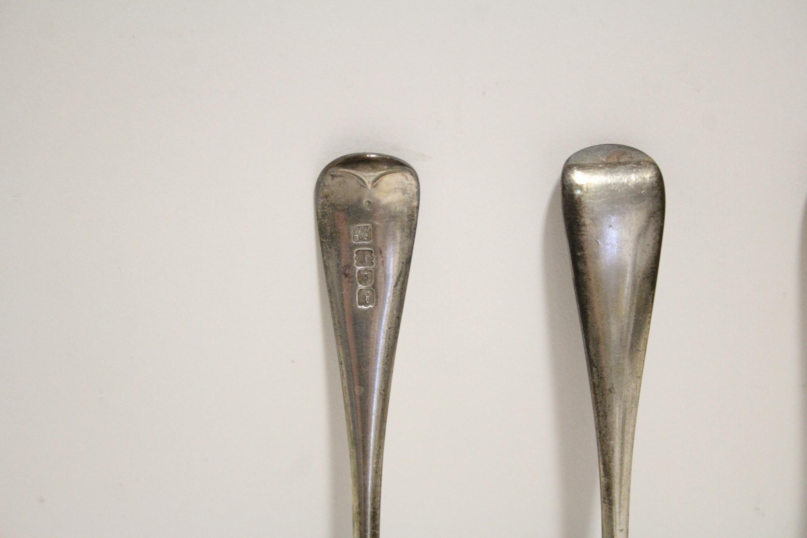 Lot 24 - Six Edwardian Old English dessert spoons; London 1901, by Johnson, Walker, & Tolhurst Ltd. (9 oz).