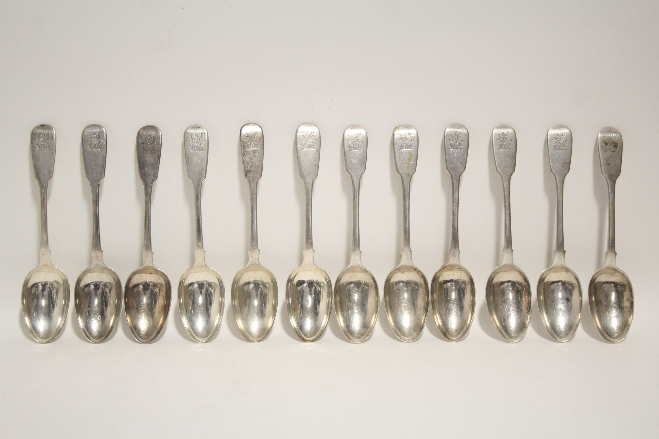 Lot 34 - Six George IV Fiddle pattern dessert spoons; London 1829; & six William IV ditto, 1834; all by