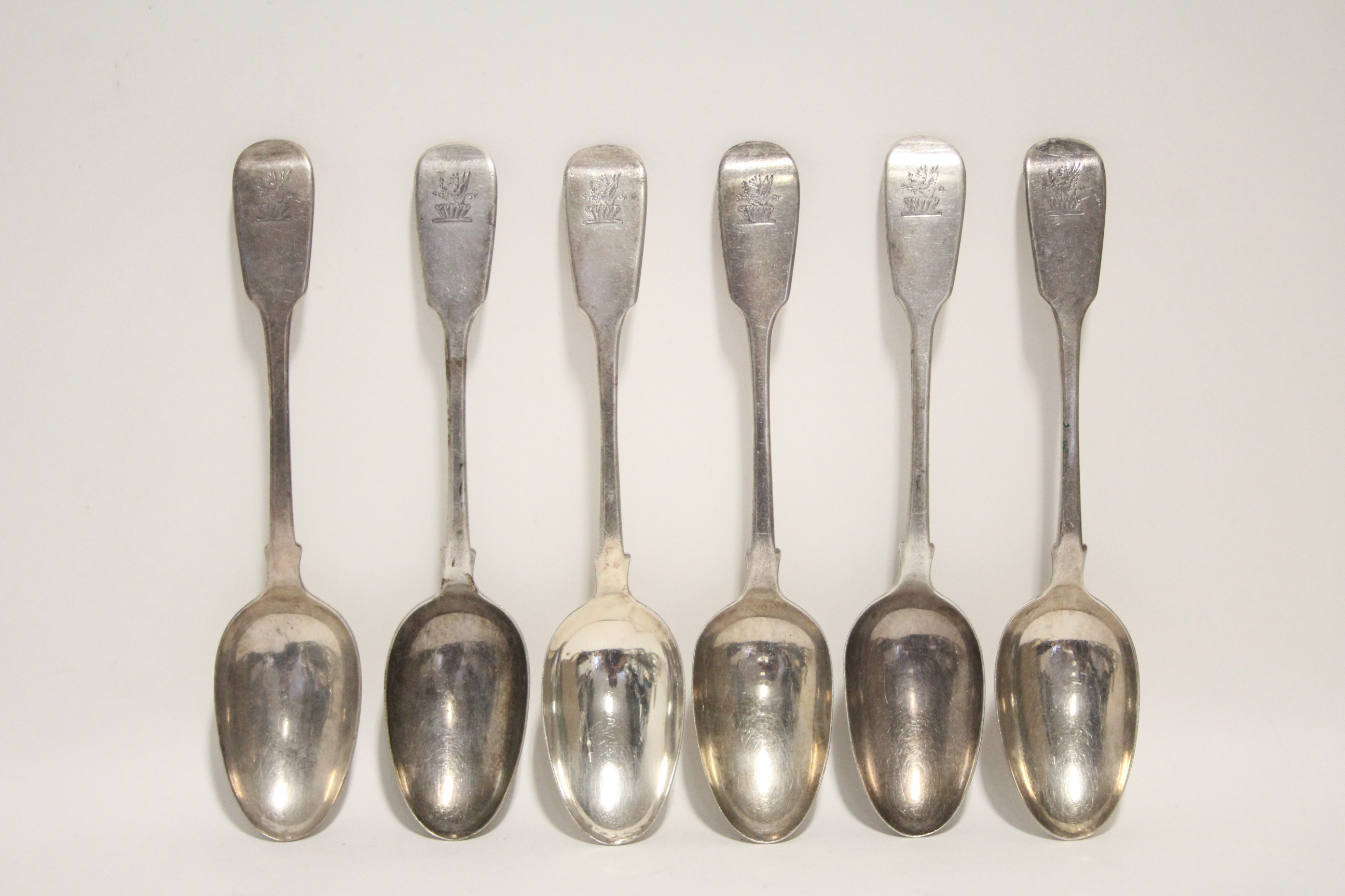 Lot 29 - Six George IV Fiddle pattern table spoons; London 1829, by William Eaton. (14½ oz).