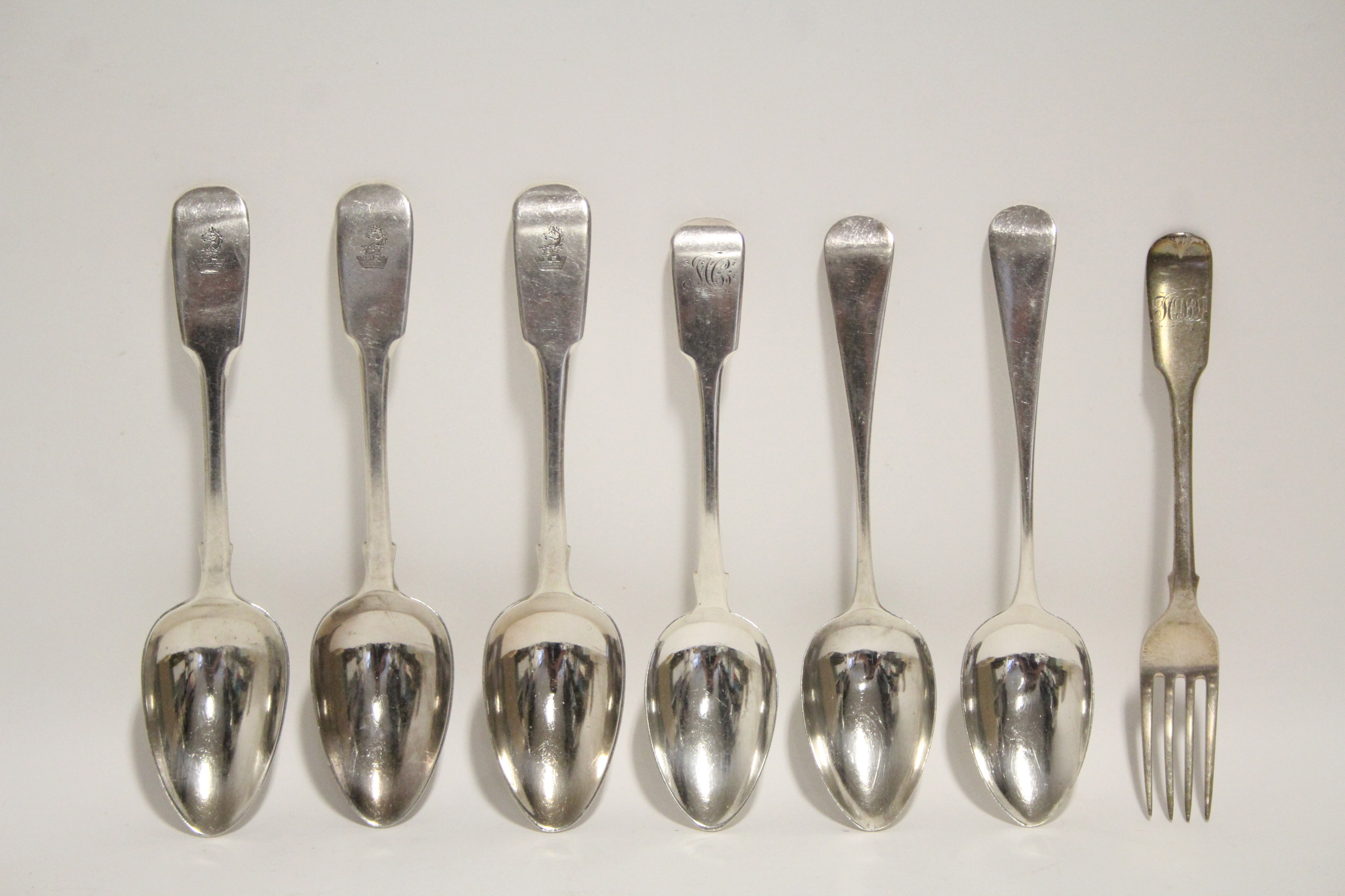 Lot 17 - Four late Georgian Fiddle pattern dessert spoons; two Old English ditto; & a Fiddle pattern