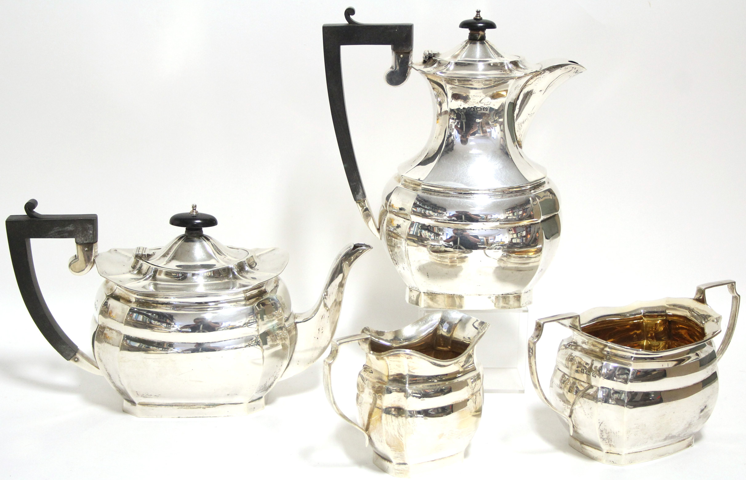 Lot 44 - A George V four-piece tea & coffee service of oblong form with canted corners; Birmingham 1931, by