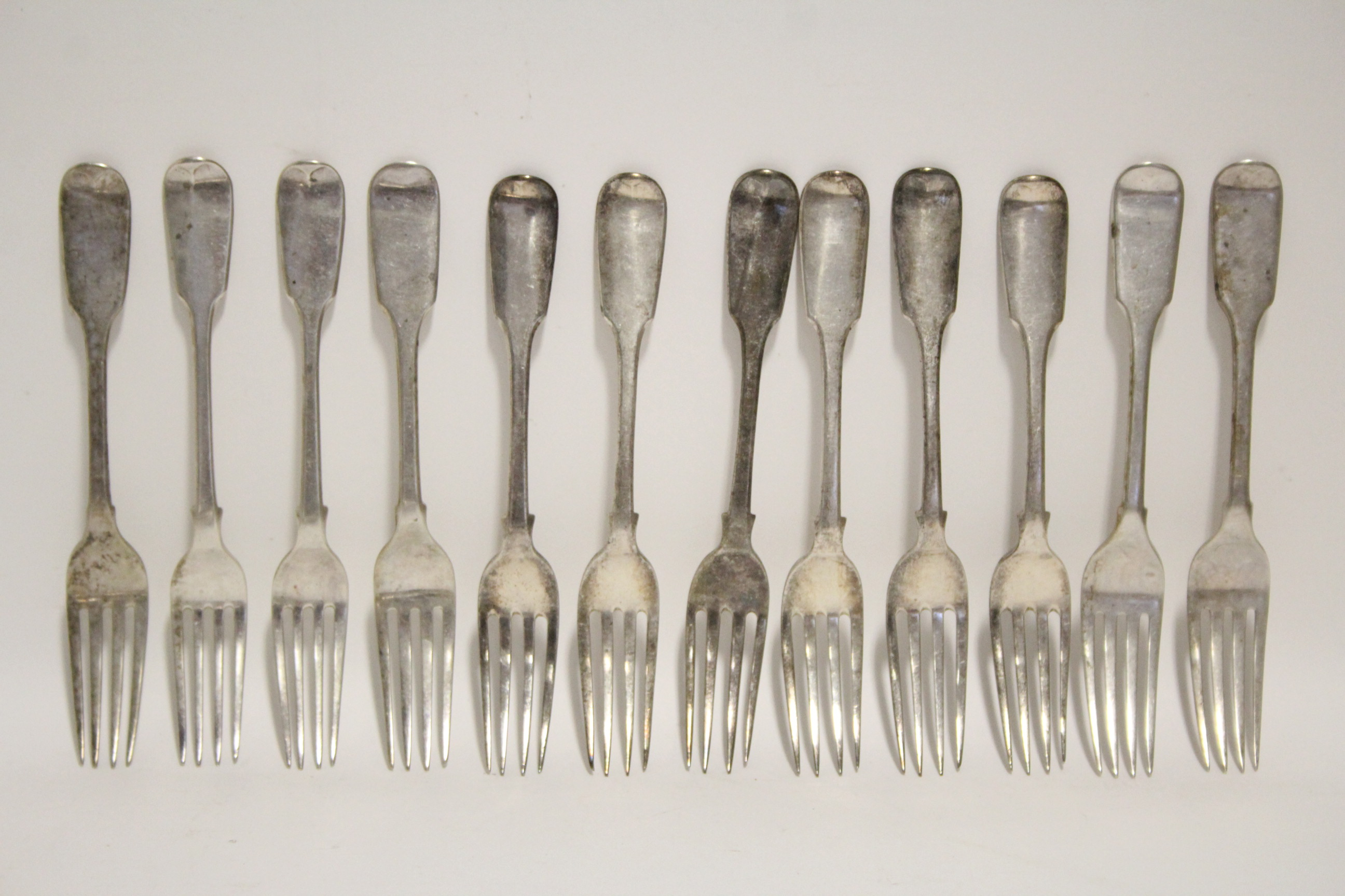 Lot 33 - Six William IV Fiddle pattern dessert forks; London 1837, by William Eaton; & six similar dessert