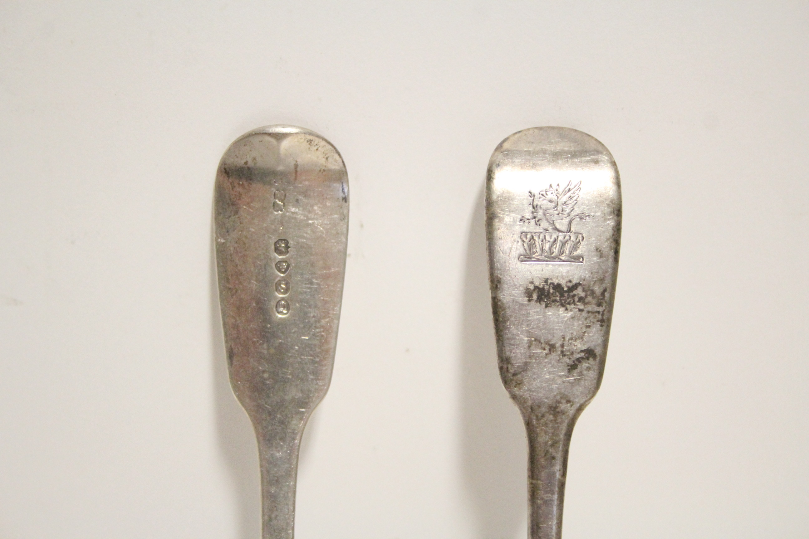 Lot 30 - Six William IV Fiddle pattern table spoons; London 1833, by William Eaton. (13 oz).