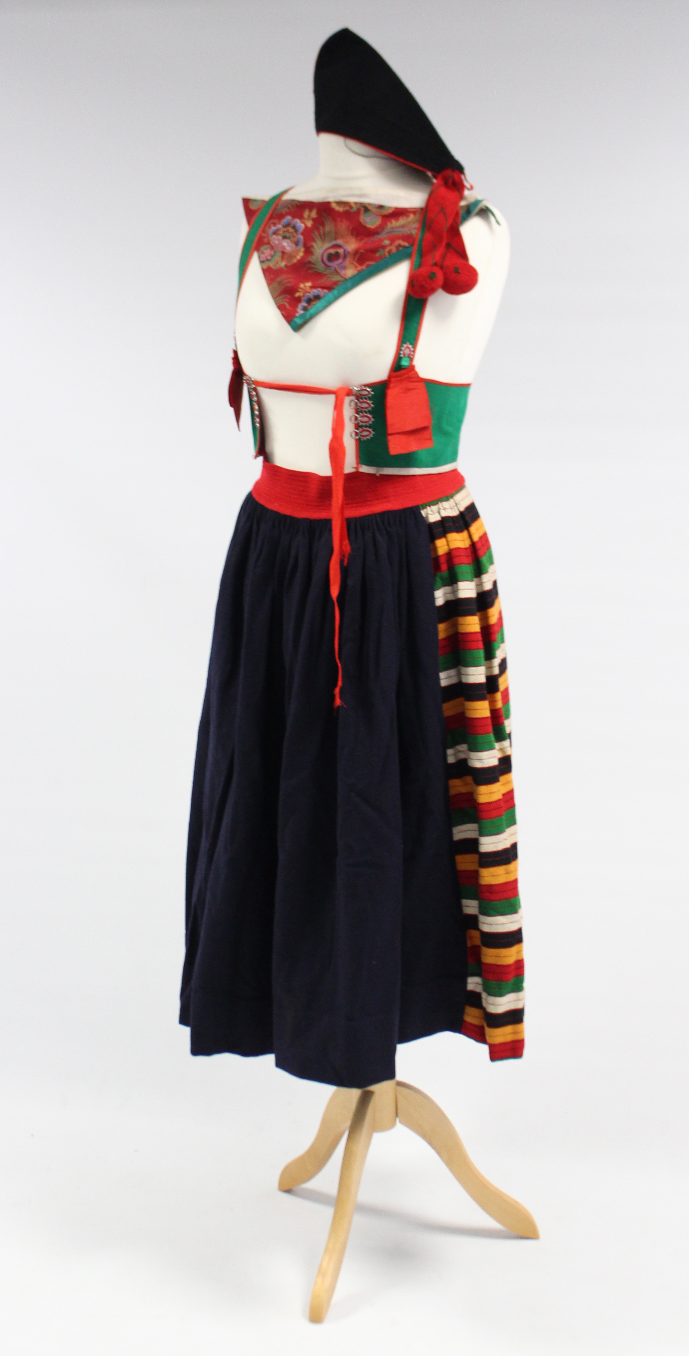 Lot 151 - A mid-20th century school girl's costume comprising a skirt, waistcoat, scarf & a hat.