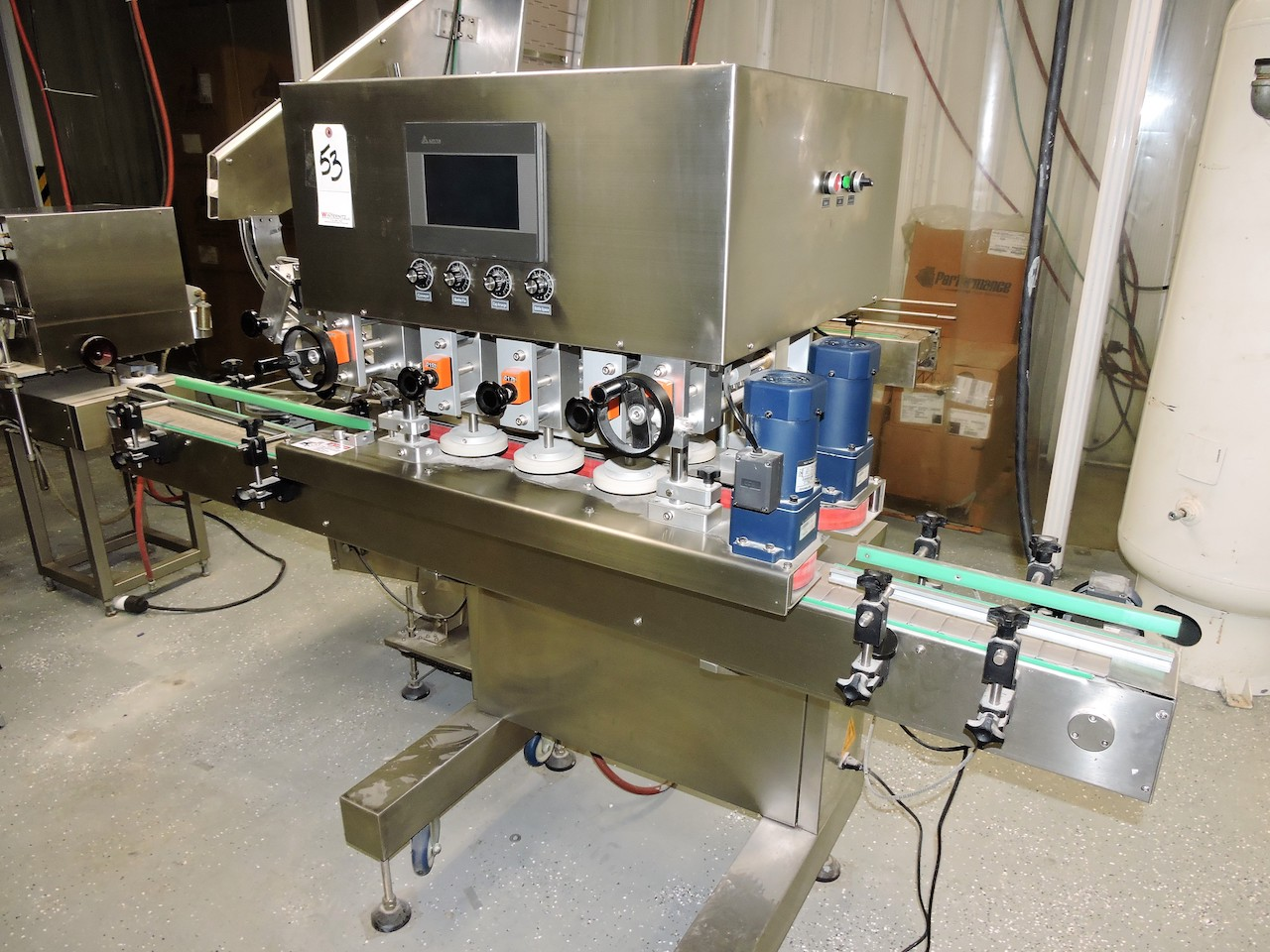 Lot 53 - 2018 DELTA CAPPER 6 SPINDLE WITH 7FT CONVEYOR WITH BXG CAP AUTO FEEDER