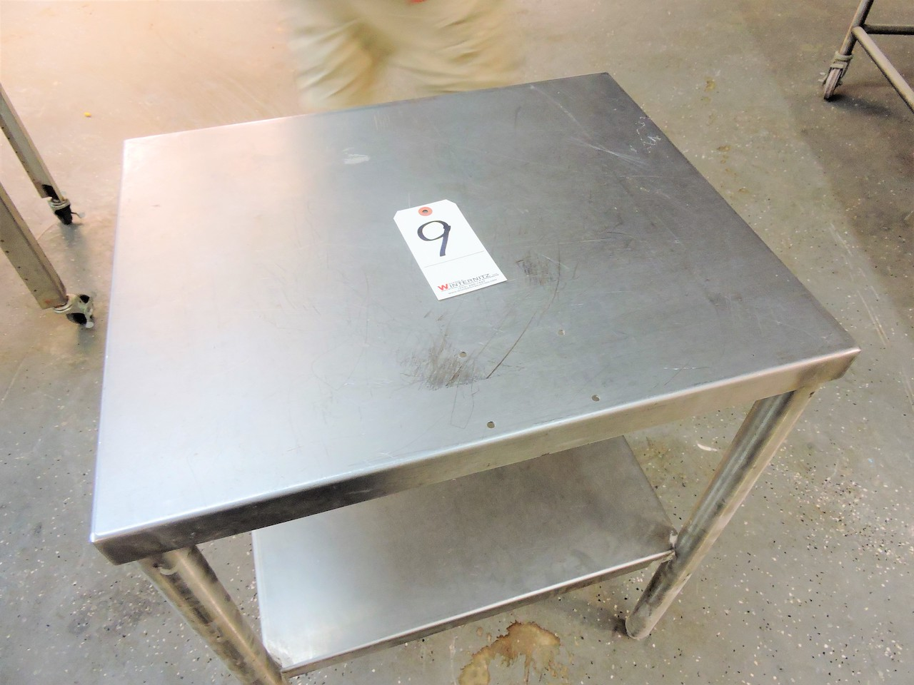 """Lot 9 - STAINLESS STEEL WORK STATION TABLE 20"""" X 24"""" X 31"""" TALL WITH SHELF"""