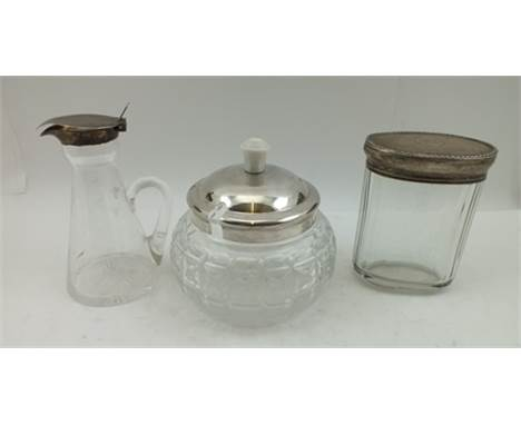 THREE SILVER MOUNTED GLASS ITEMS; an Art Deco conserve jar, the silver cover with Bakelite knop handle, cut glass body, hallm