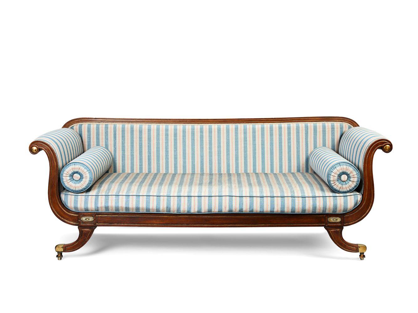 A Regency beechwood, parcel-gilt and brass-mounted scroll-end sofa, circa 1815