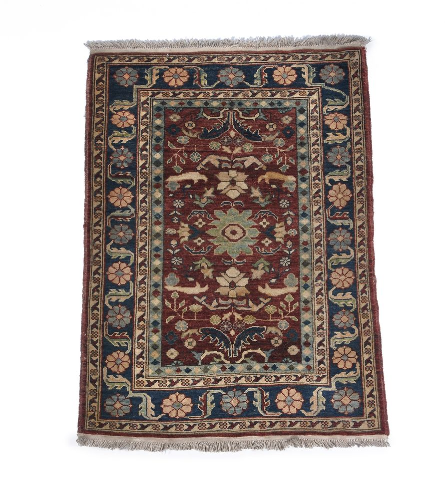 A North West Persian runner, small North West Persian rug and a Kashan rug