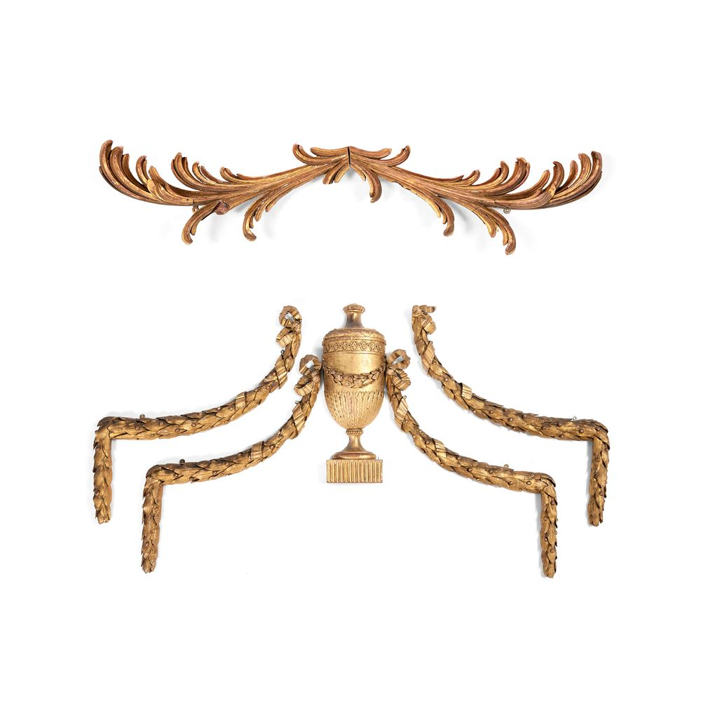 A set of four carved and giltwood wall mounts, 18th century and later