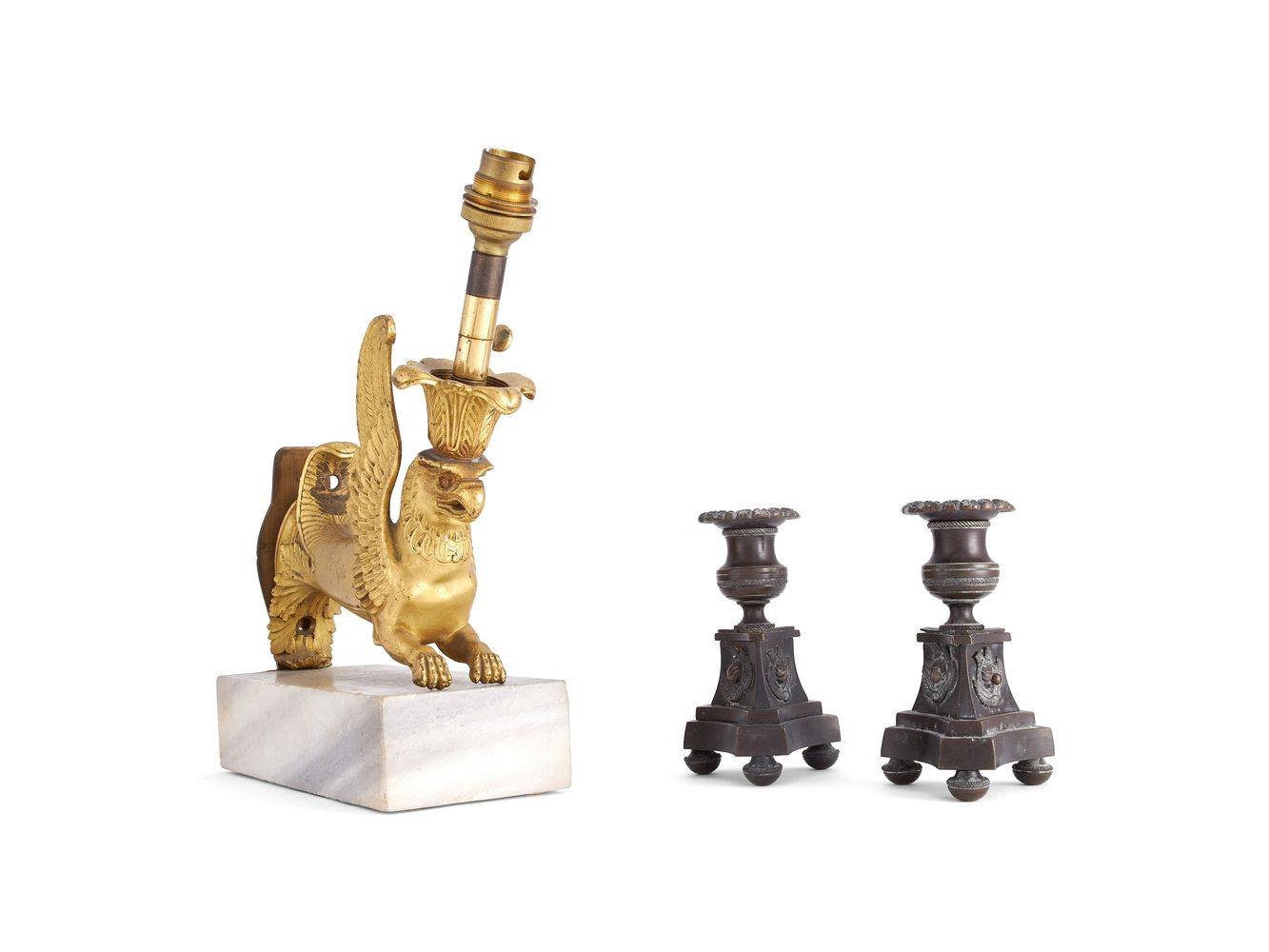 A pair of Empire patinated bronze candle holders, circa 1810, and a Regency gilt bronze mount refitt