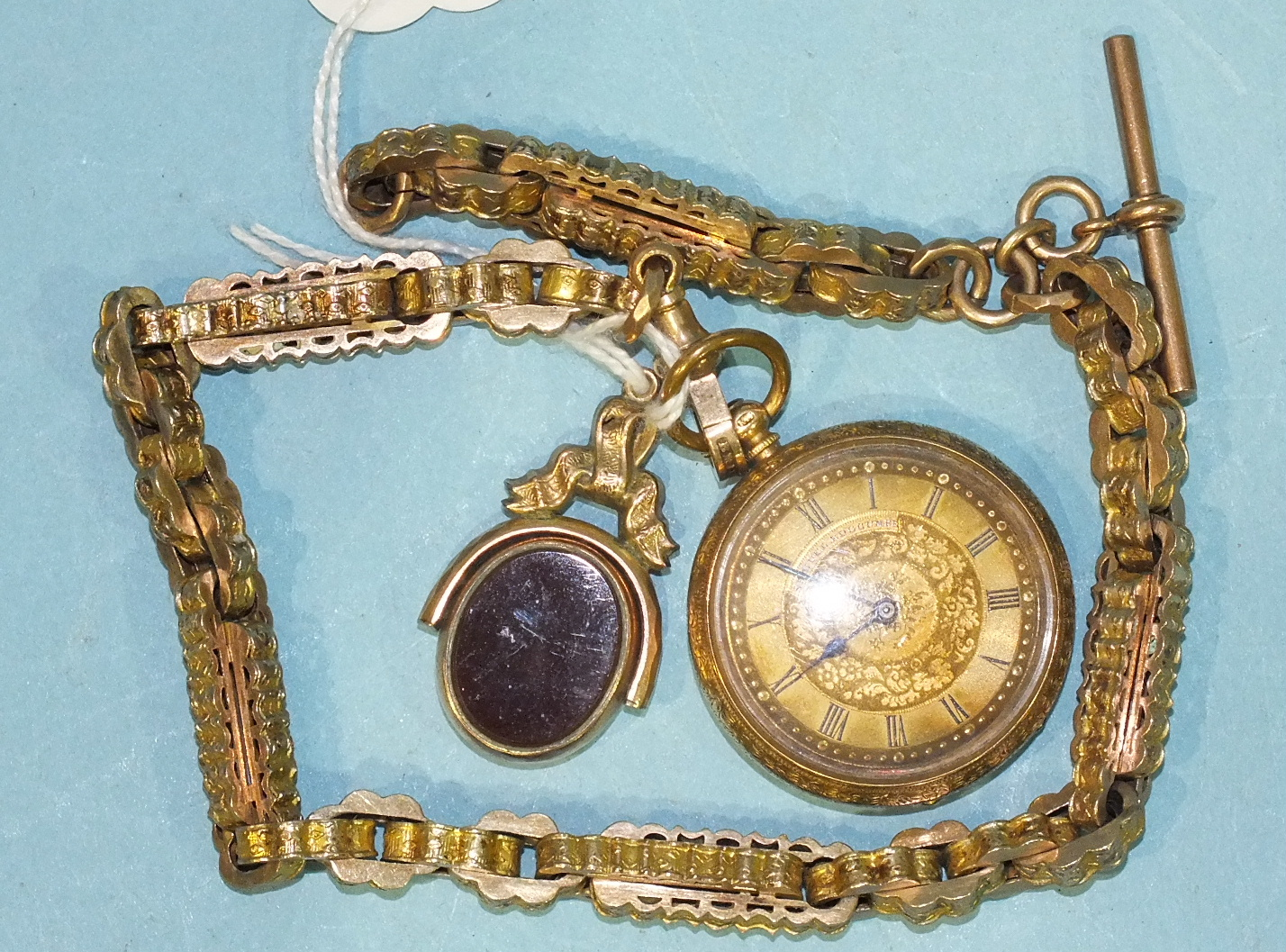 Lot 303 - A 14k gold-cased keywind open-face pocket watch, 35mm diameter, a gold-mounted swivel fob and a gilt