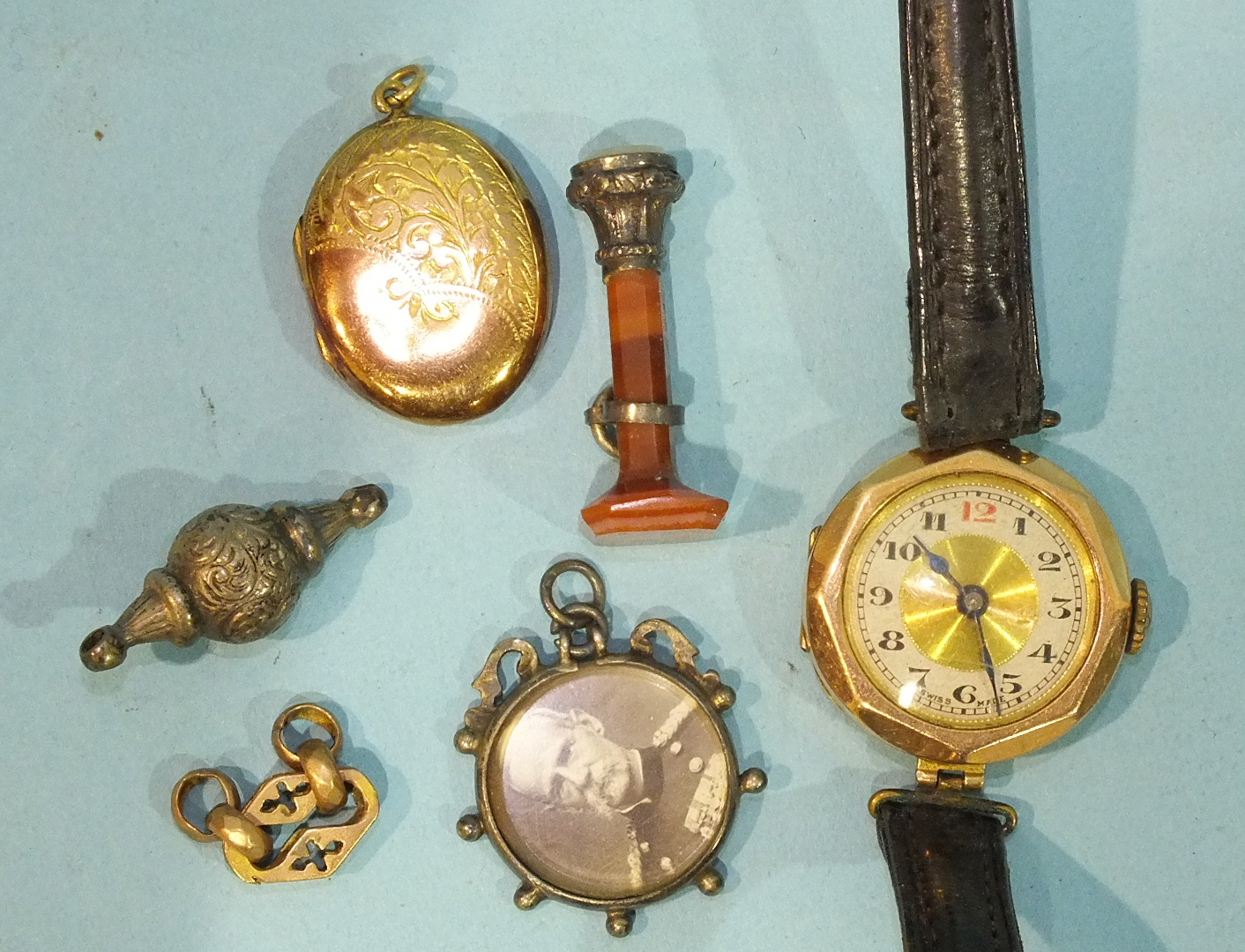 Lot 325 - A small 9ct gold faced locket, an agate seal, a gold cased wrist watch and other items.
