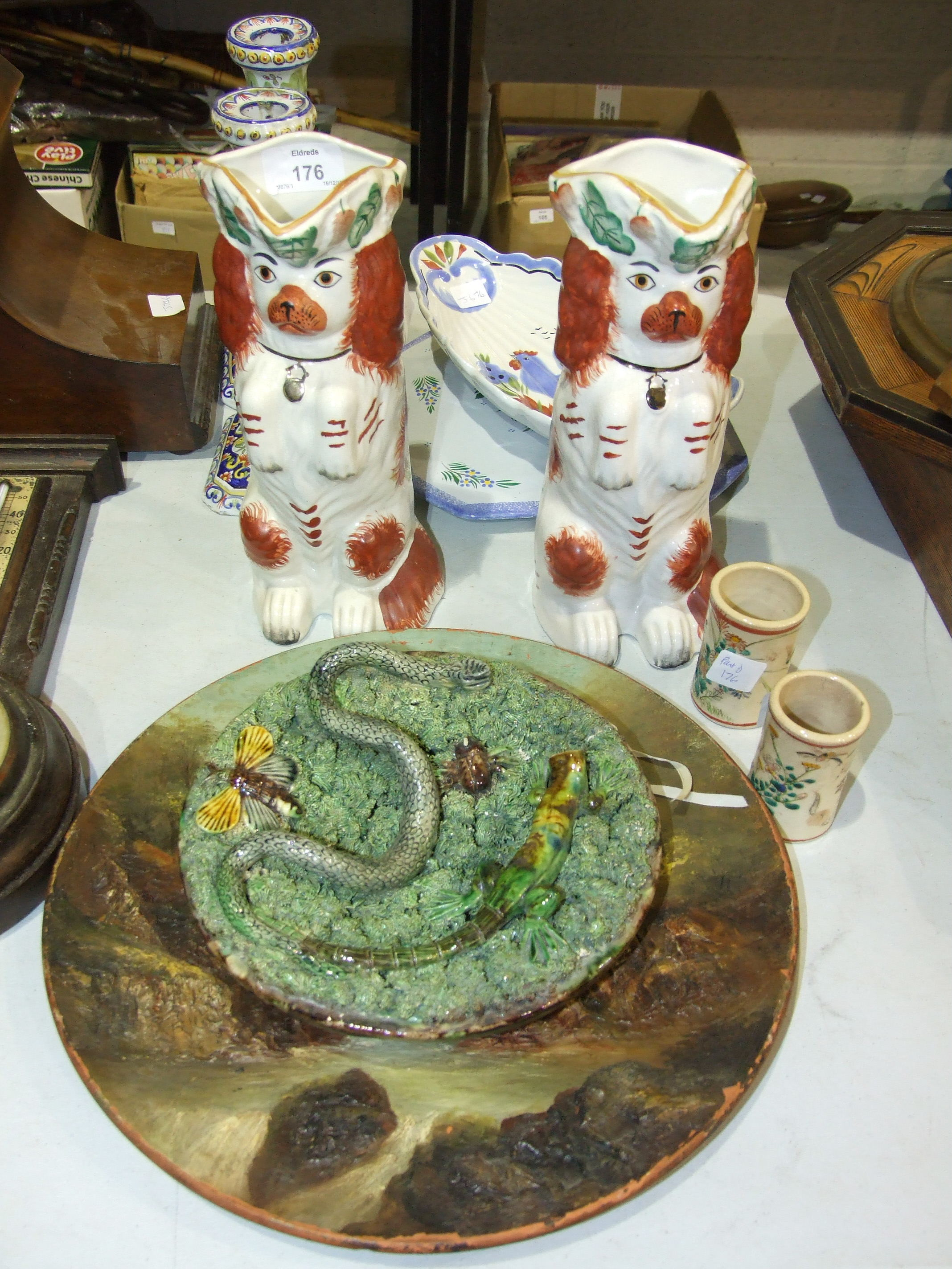 Lot 176 - A pair of Staffordshire jugs in the form of begging Spaniels, 26cm high, a Watcombe circular
