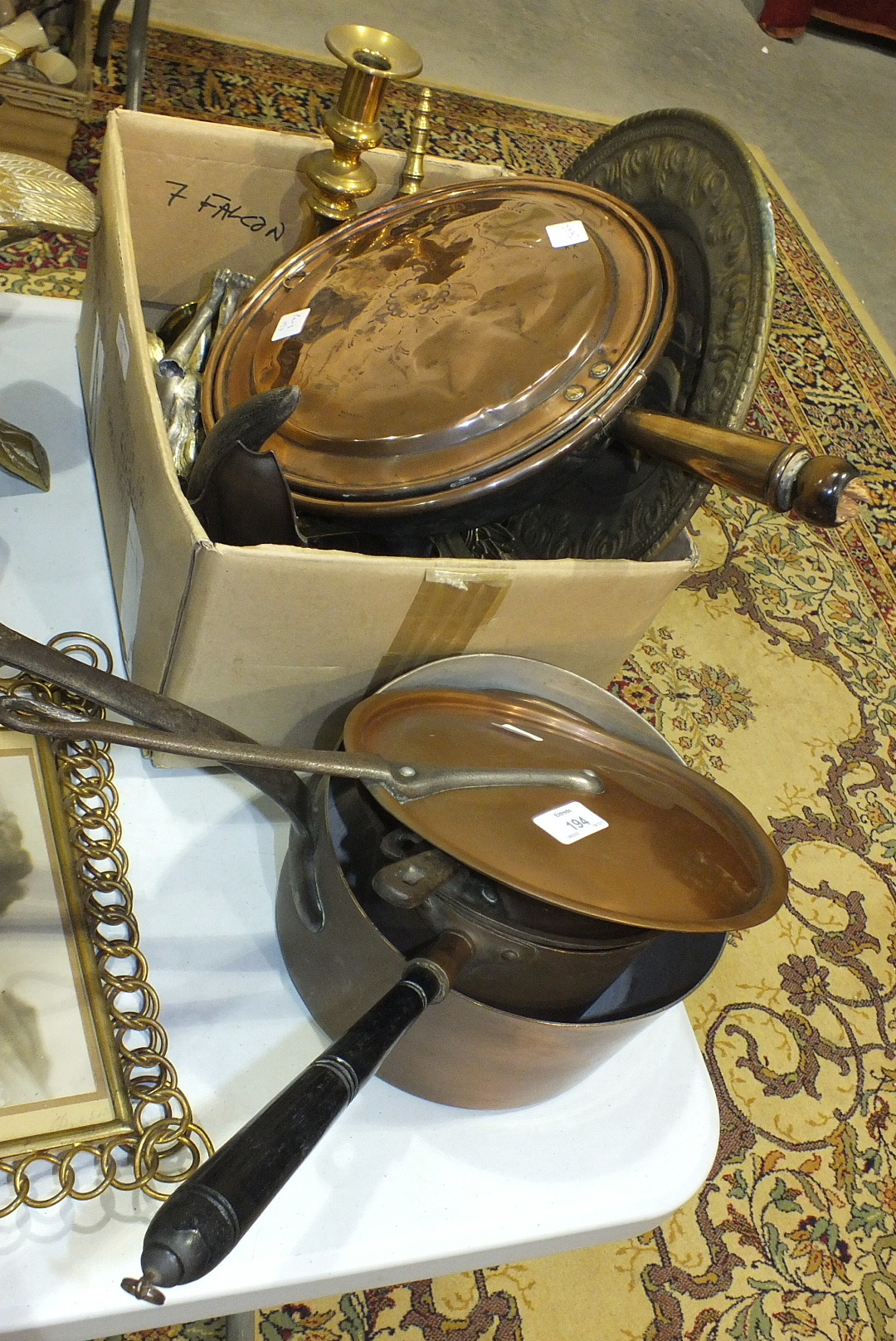 Lot 194 - A pressed brass photo frame, 28 x 22cm, two pierced metal tazze, two copper saucepans and lids and