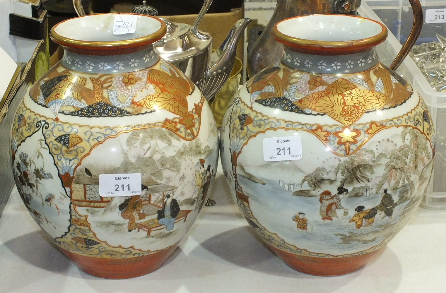 Lot 211 - A pair of large 19th century Japanese Kutani vases decorated with figures in a lakeland setting,
