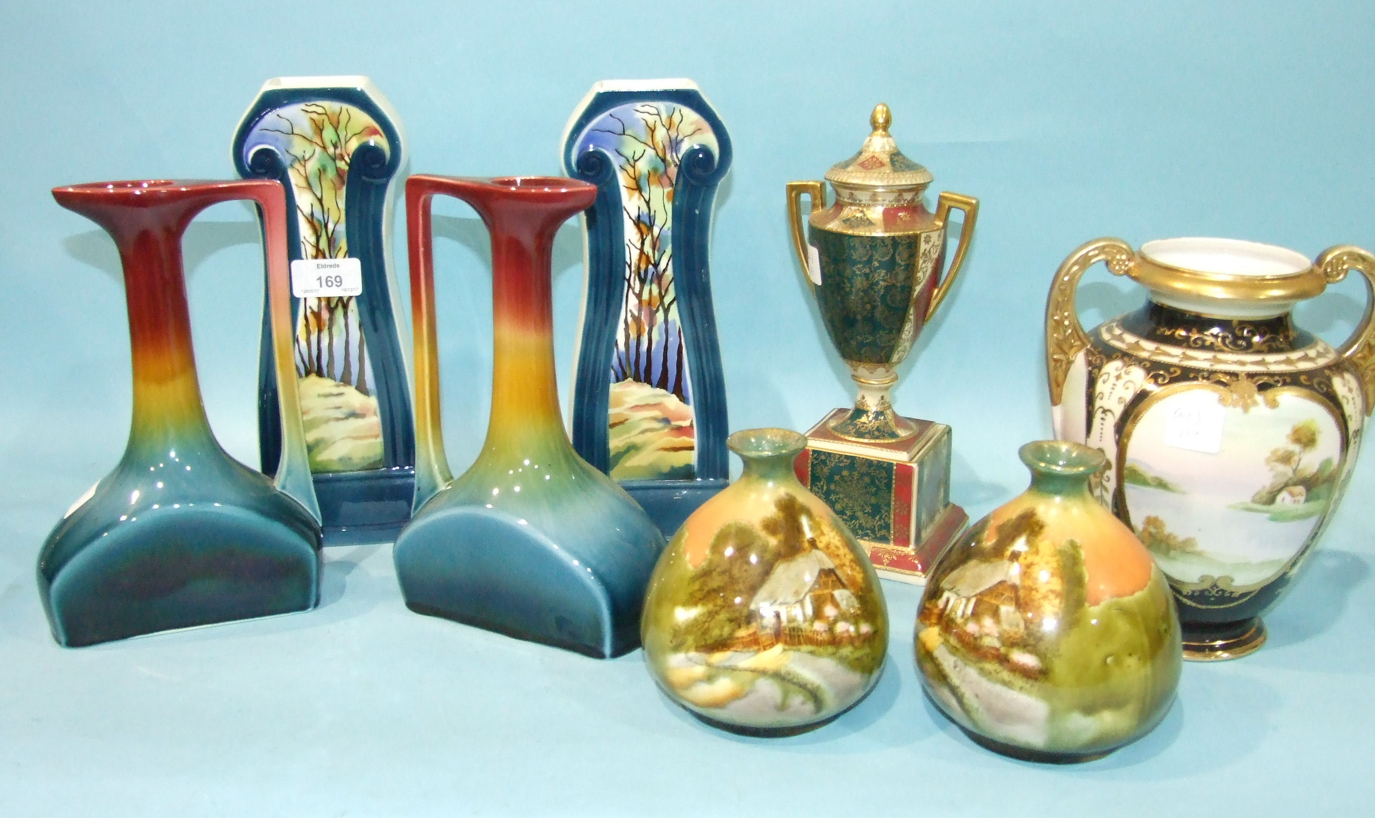 Lot 169 - A pair of Continental ceramic Art Nouveau-style vases painted with a woodland design, 27cm high, (