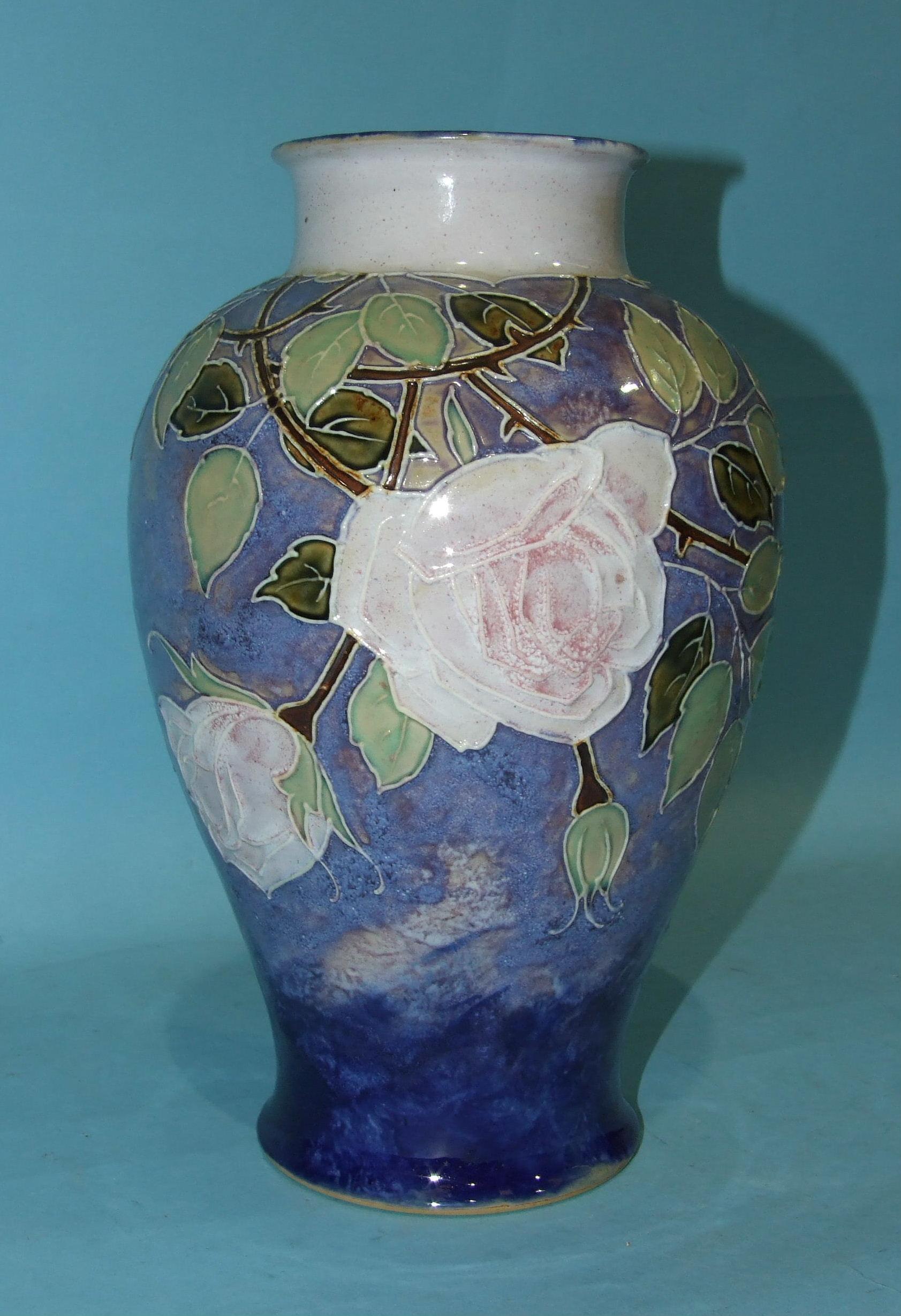 Lot 146 - A large Royal Doulton baluster stoneware vase with tubeline decoration of roses and foliate