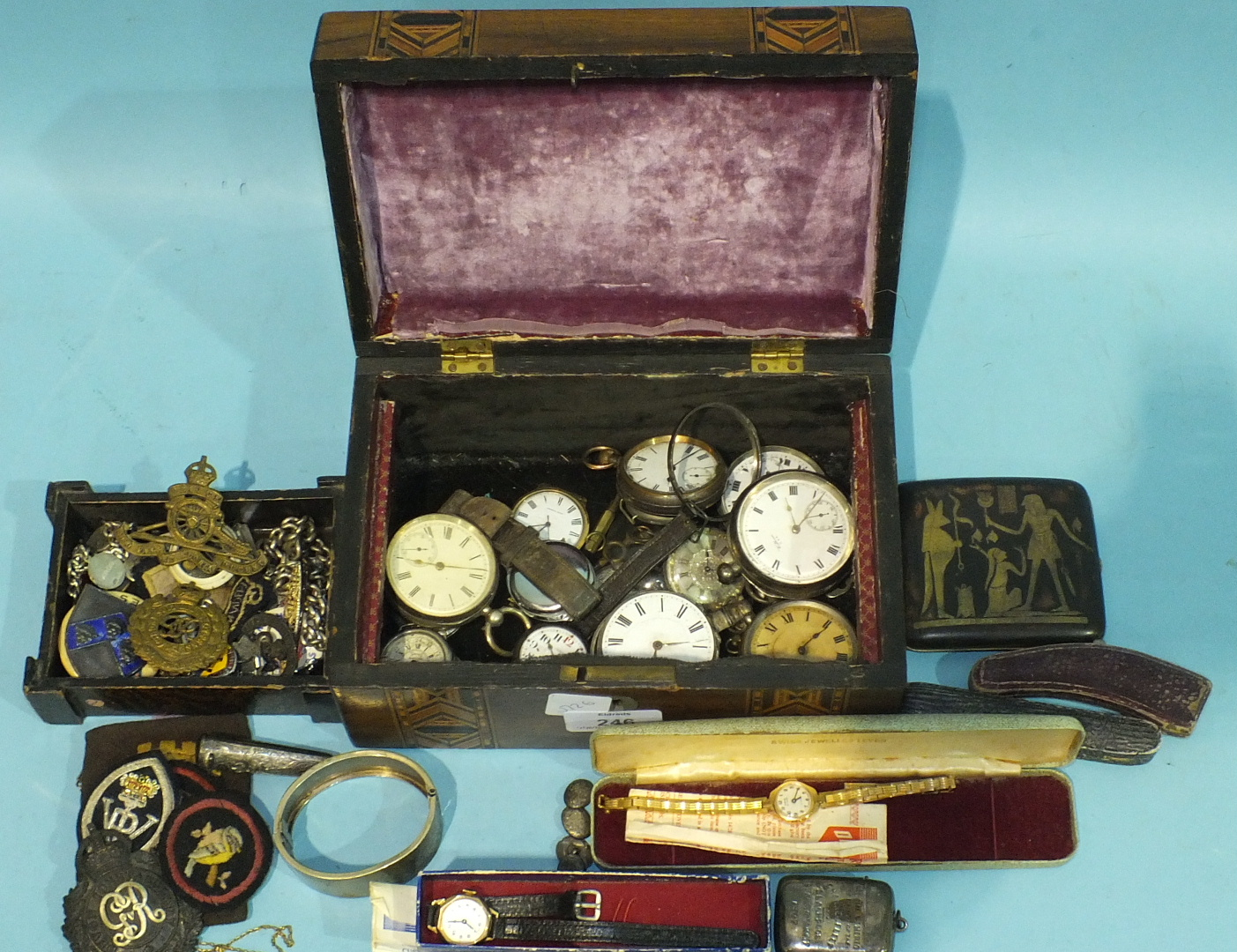 Lot 246 - A J Benson silver cased wrist watch (af), other watches, various military and other badges and other