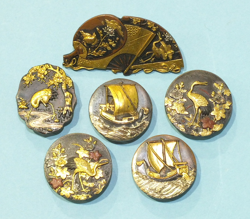 Lot 350 - A Japanese Shakudo brooch in the form of a fan overlaid with two smaller fans, three Shakudo buttons