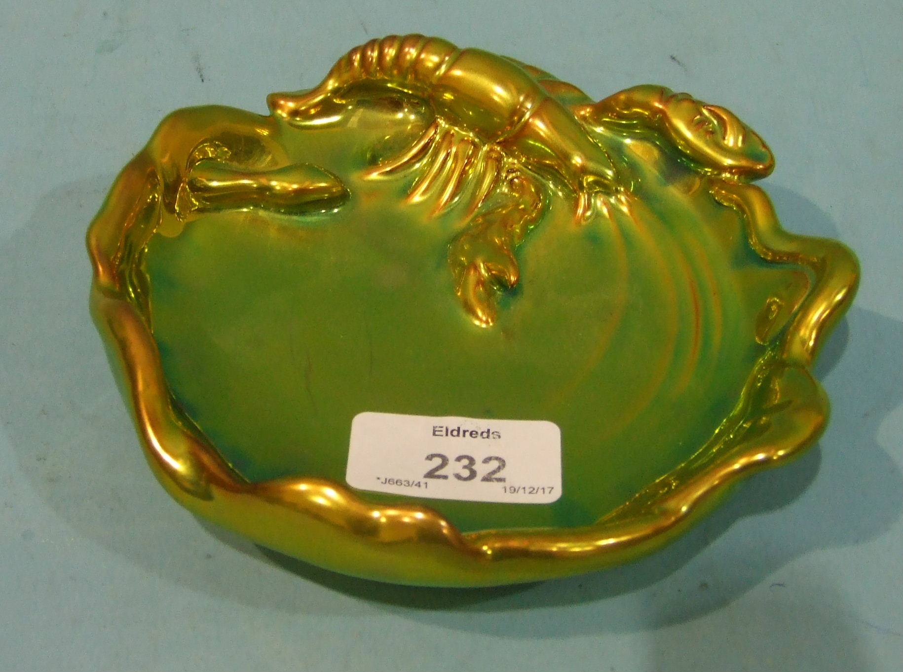 Lot 232 - A Zsolnay Pecs green lustre dish relief-moulded with a lobster in a rock pool, 14cm diameter,