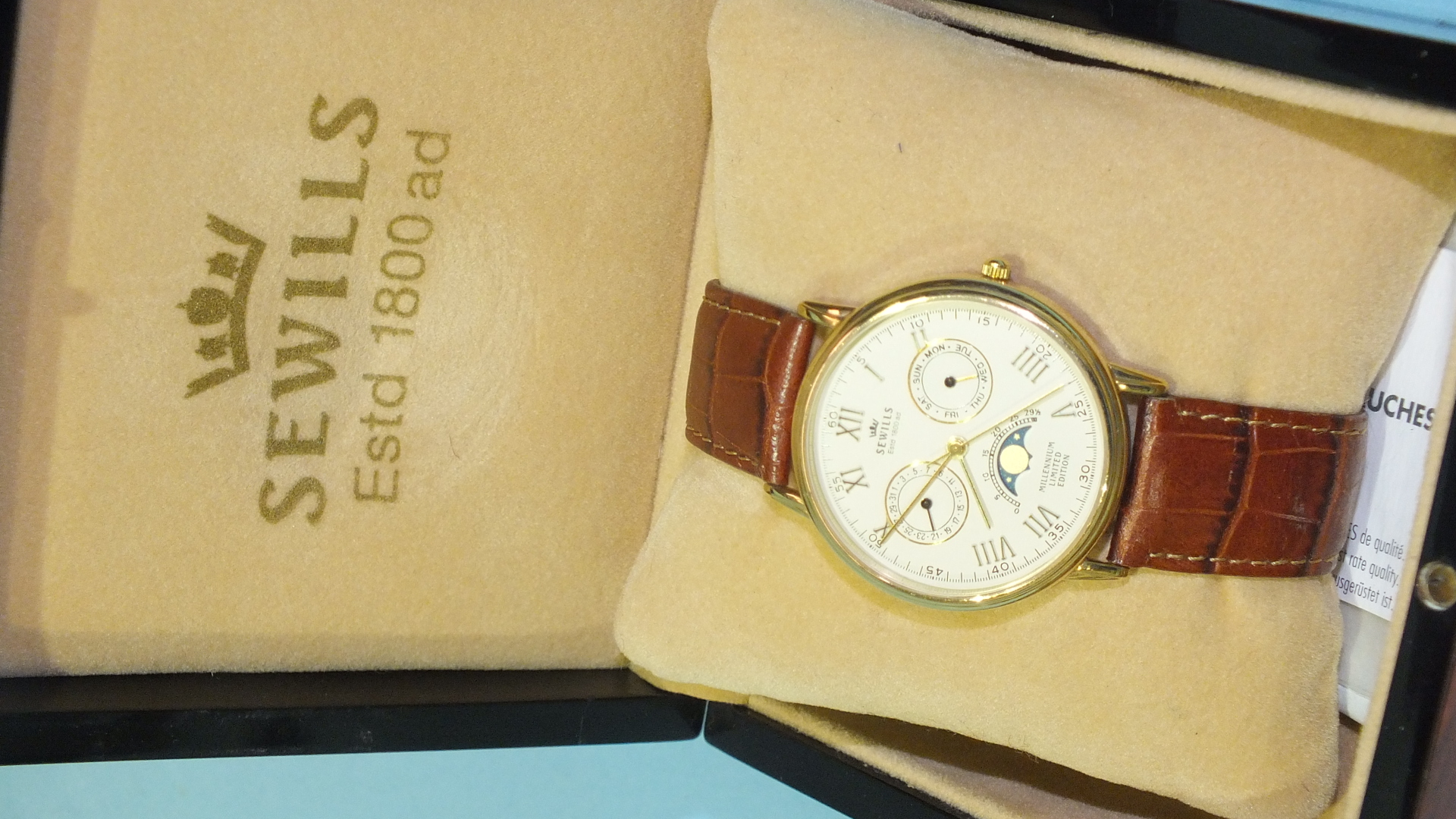 Lot 276 - Sewills Millennium calendar moon-phase wrist watch, no.194 of limited edition of 2000, the cream