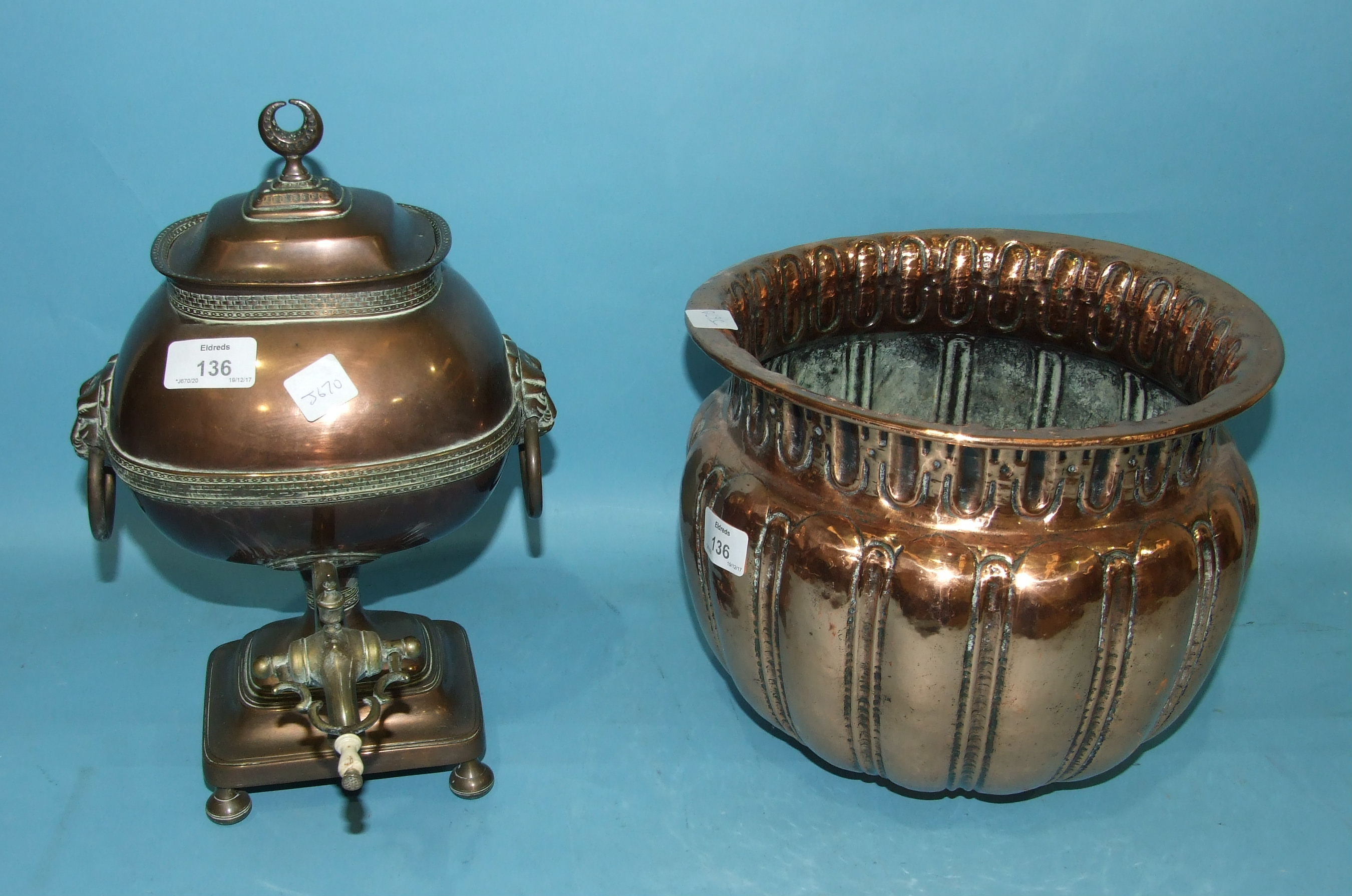 Lot 136 - A 19th century Asian copper samovar, the lion mask ring handles and brass tap complete with interior