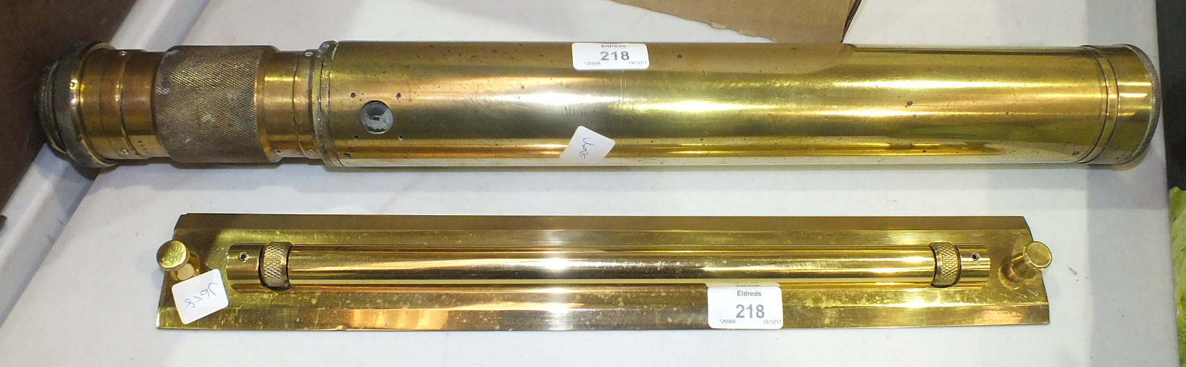 Lot 218 - A brass rolling ruler and a brass gun sight by Ross, London, no.40127, (2).