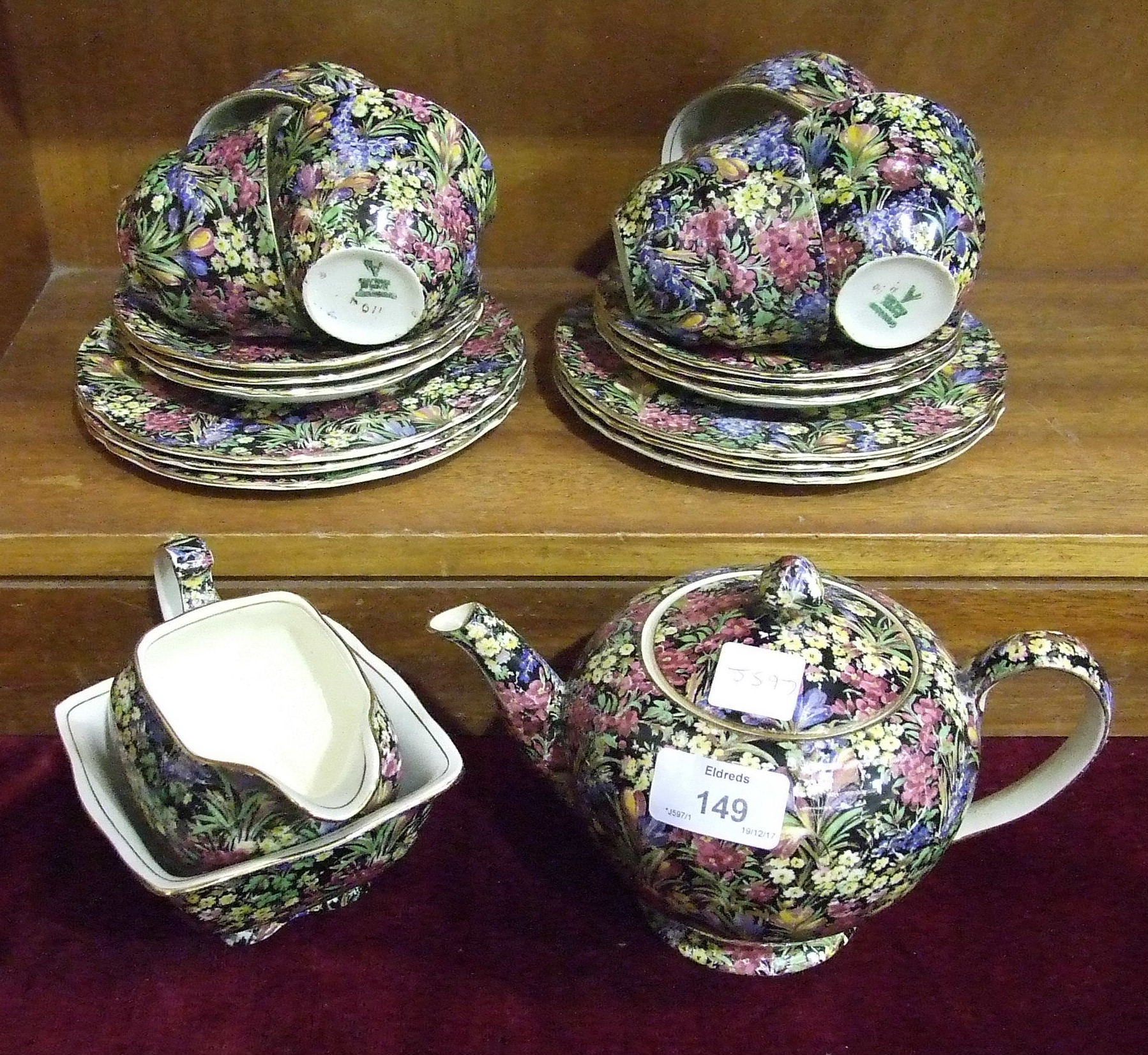 Lot 149 - A Grimwades Royal Winton tea service with profuse overall foliate decoration, 21 pieces.