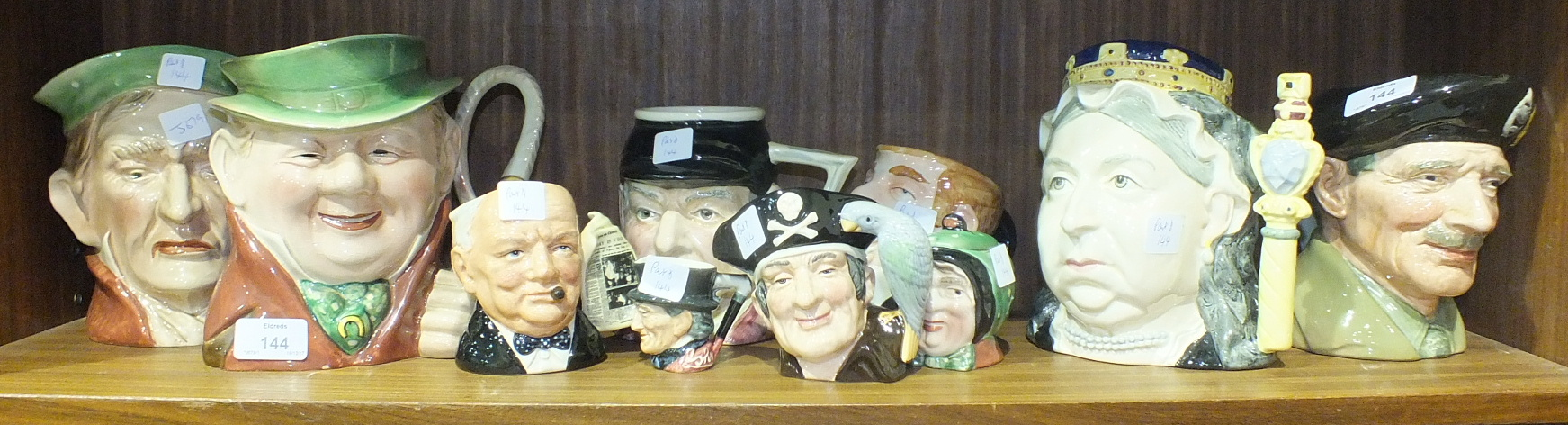 Lot 144 - A collection of Royal Doulton and Beswick character jugs, including 'Monty', (10).