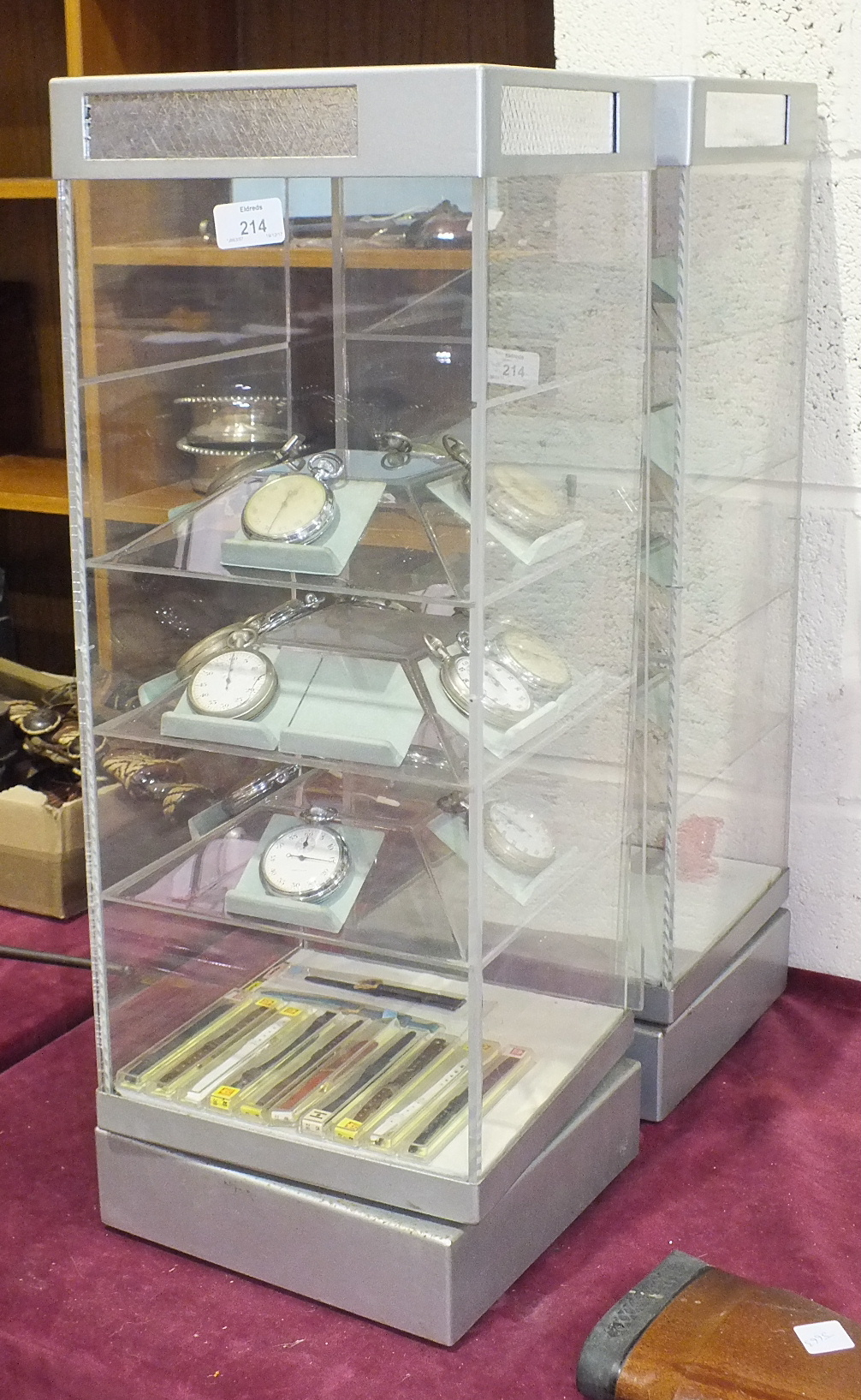 Lot 214 - Two Perspex counter display units with electric revolving mechanism, together with a collection of