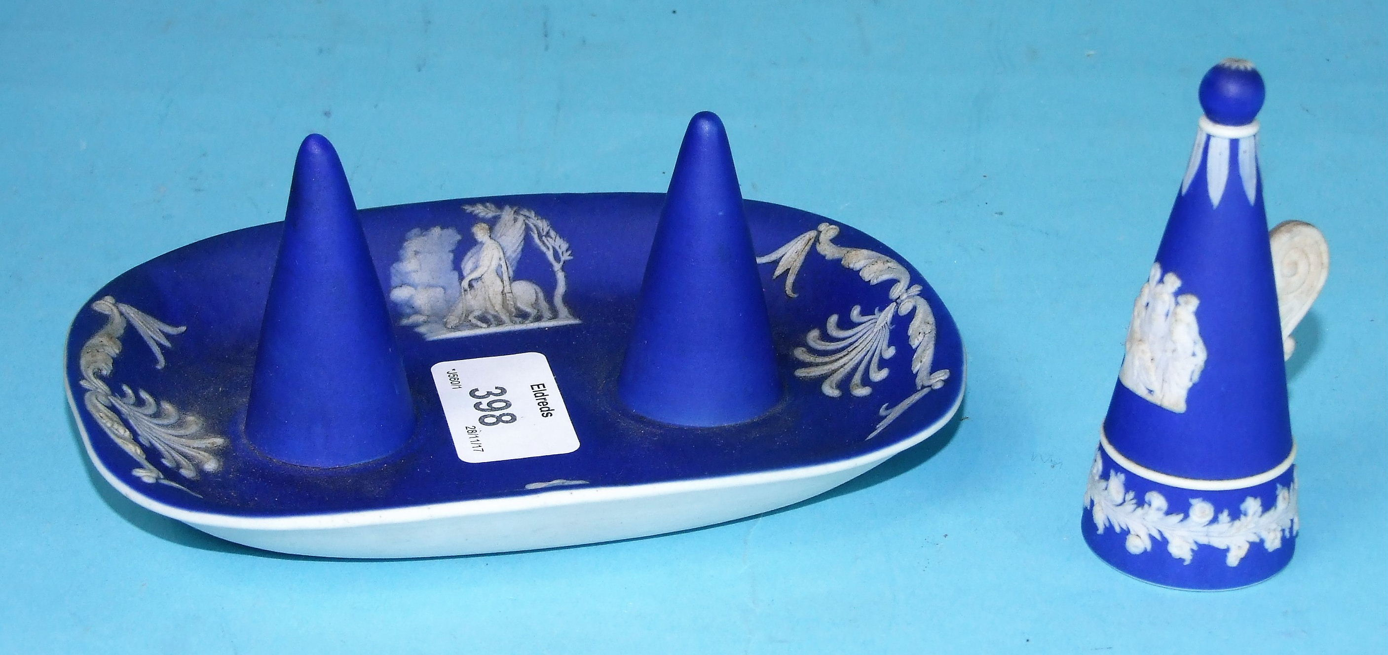 Lot 221 - A 19th century blue and white jasperware double candle snuffer depicting classical figures, only one